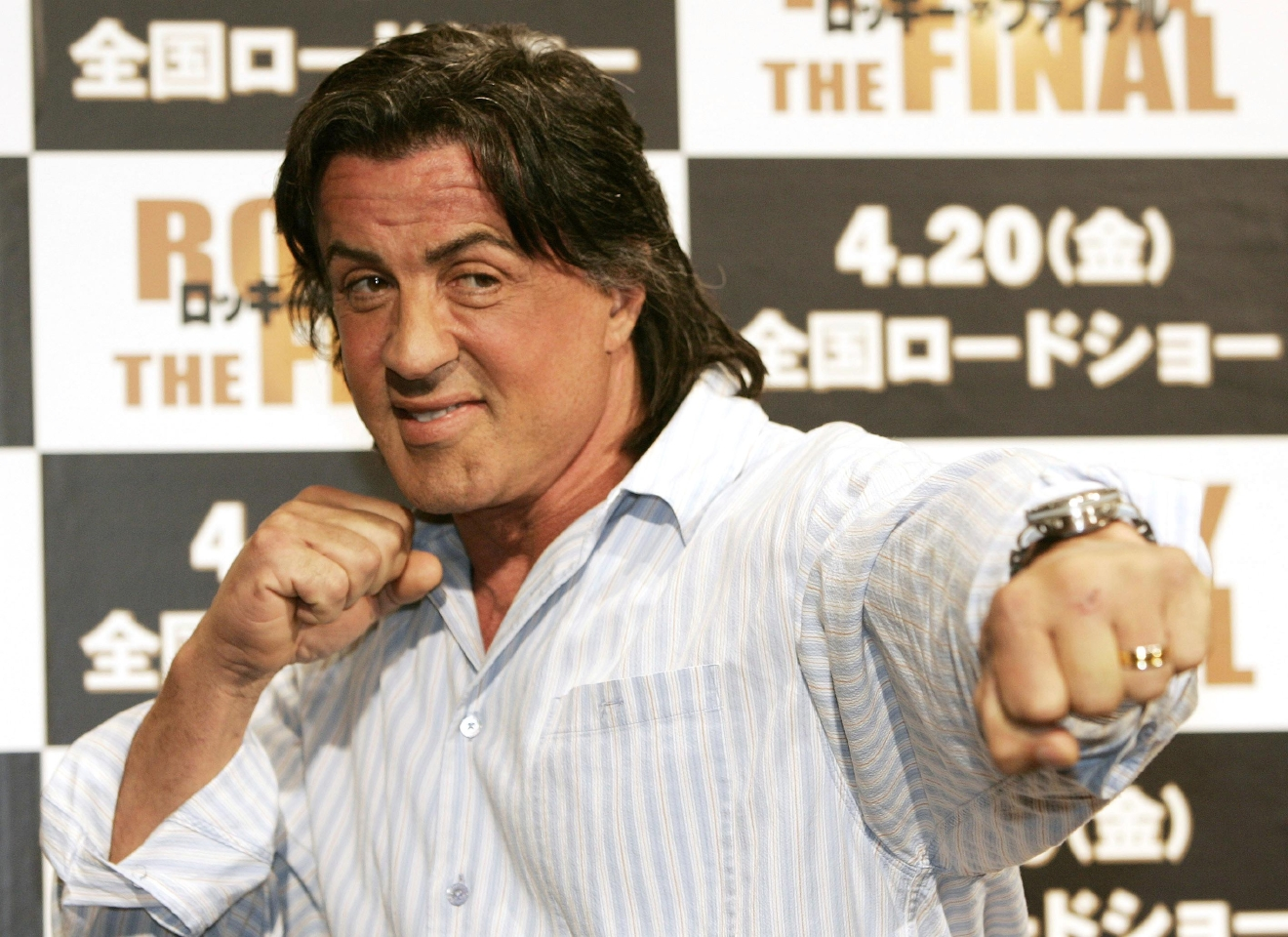 "FILE – In this March 26, 2007, file photo, actor and screenwriter Sylvester Stallone poses for a photo during a news conference to promote the movie ""Rocky Balboa"" at a hotel in Tokyo. Four decades after the Nov. 21, 1976, premiere of ""Rocky,"" the movie's reach is international, and the title character's underdog tale of determination, grit and sleepy-eyed charm still resonates with fans. (AP Photo/Vincent Thian, File)"
