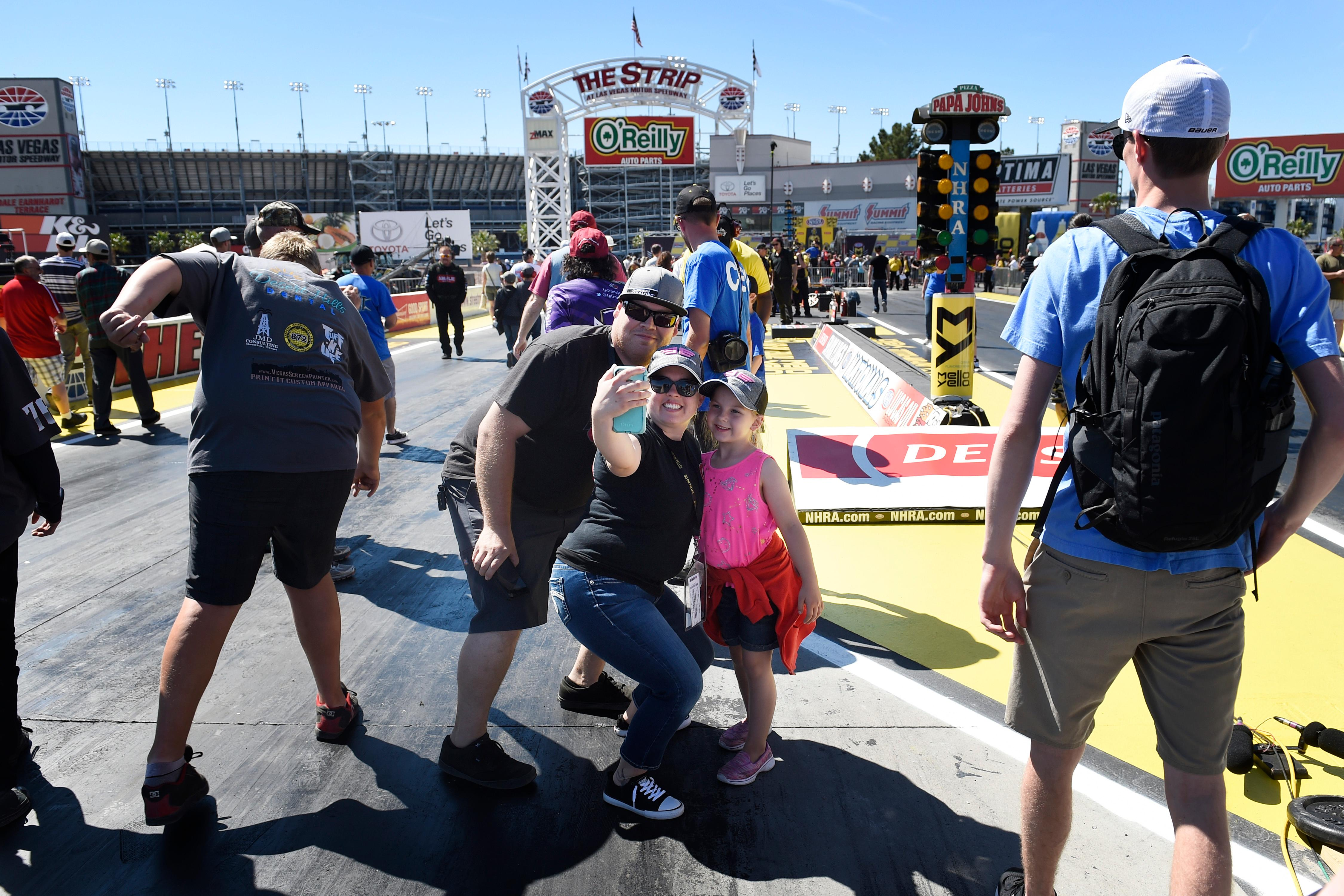 Race fans take a selfie before the NHRA DENSO Spark Plug Nationals at The Strip at the Las Vegas Motor Speedway Sunday, April 2, 2017. (Sam Morris/Las Vegas News Bureau)