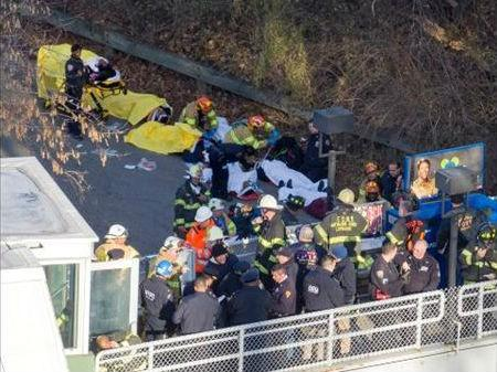 Injured people are tended to by first responders near the site of the derailment.
