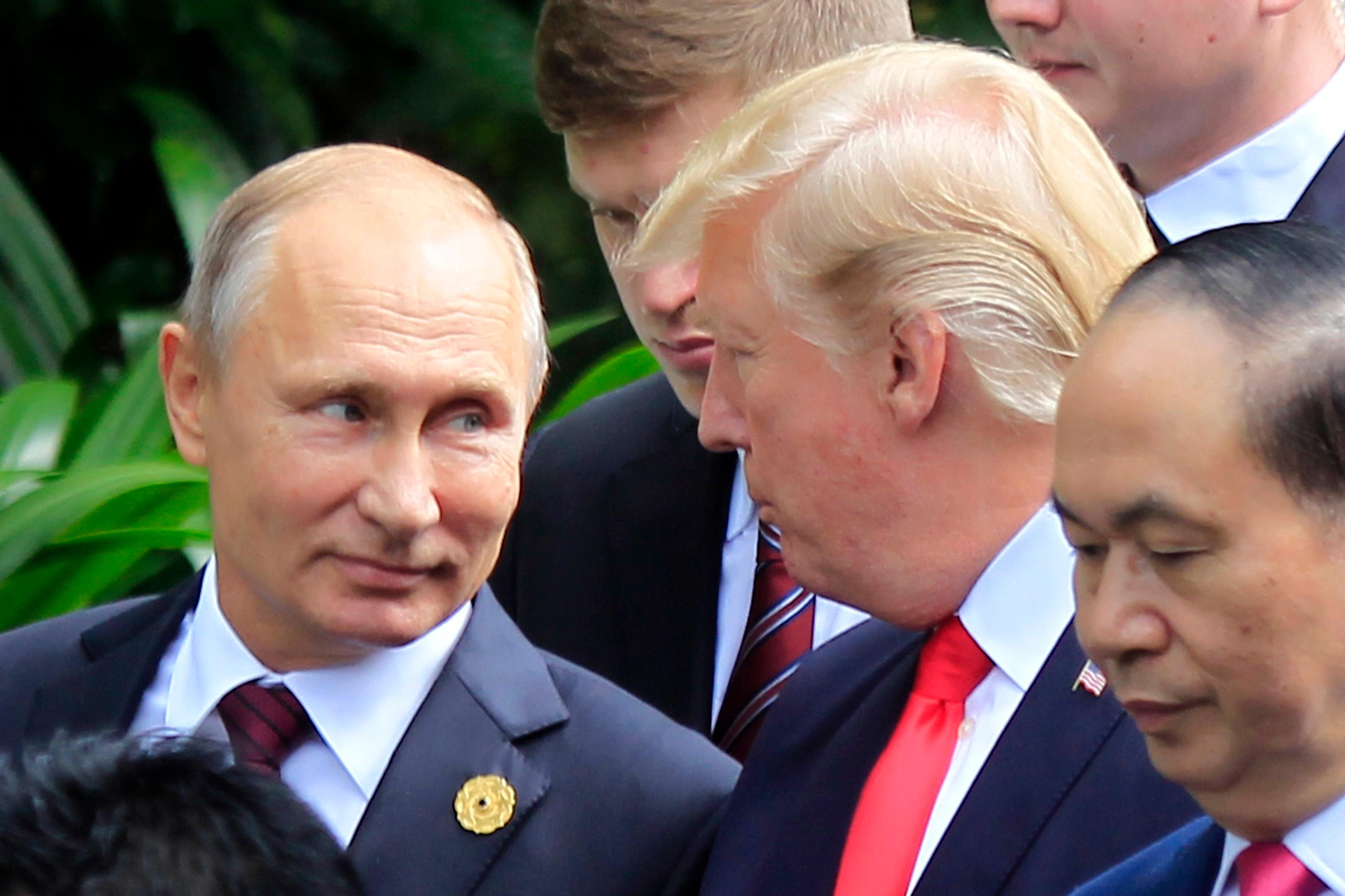 Russian President Vladimir Putin, left, and U.S. President Donald Trump talk as they arrive for the family photo session during the Asia-Pacific Economic Cooperation (APEC) Summit in Danang, Vietnam, Saturday, Nov. 11, 2017. (AP Photo/Hau Dinh)<p></p>