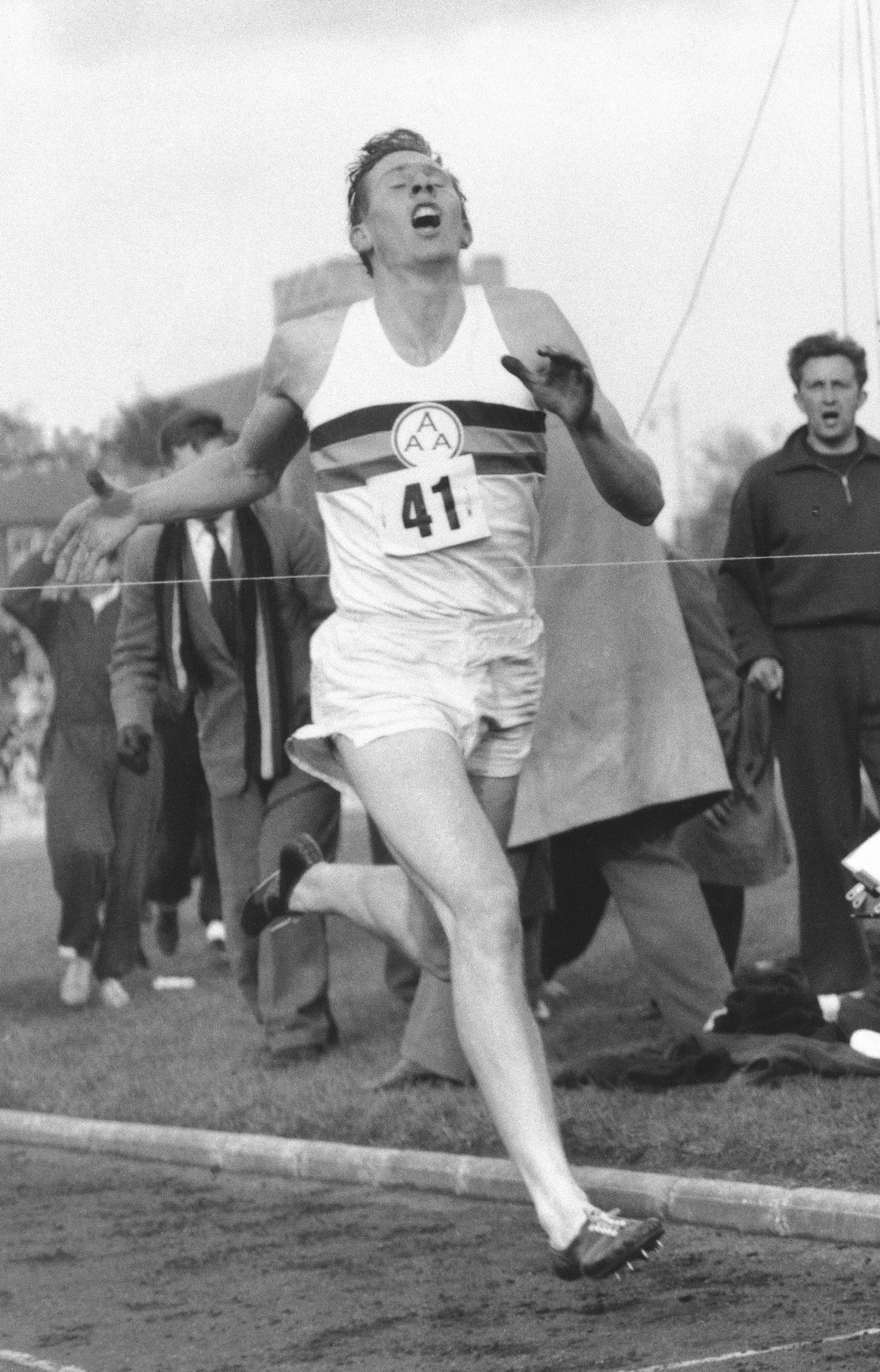 FILE - In this May 6, 1954 file photo, Britain's Roger Bannister hits the tape to break the four-minute mile in Oxford, England. A statement released Sunday March 4, 2018, on behalf of Bannister's family said Sir Roger Bannister died peacefully in Oxford on March 3, aged 88. (AP Photo/File)