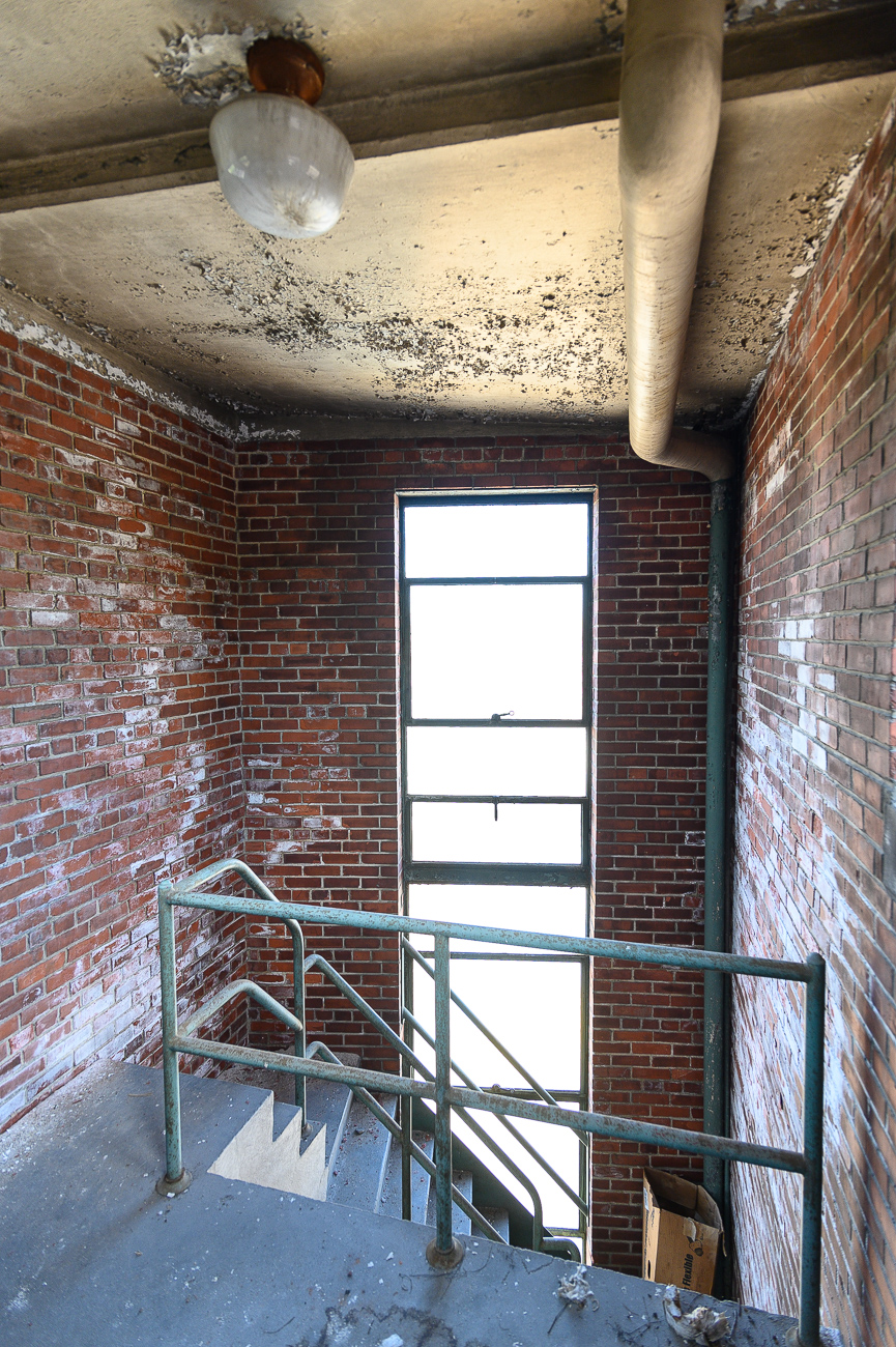A spiral staircase leads to the top of the four-story tower that rises from the back of the station. Fire hoses were draped over racks in the tower to allow them to properly dry. / Image: Phil Armstrong, Cincinnati Refined // Published: 10.4.19