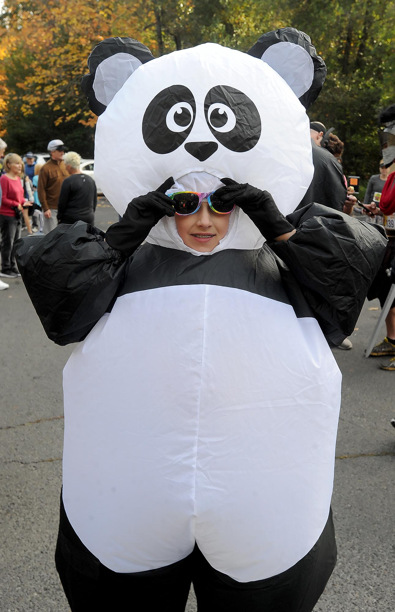 Max Rogers, 10, of Ashland, dons a blow-up panda suit for the Monster Dash run in Lithia Park. Photo by Denise Baratta