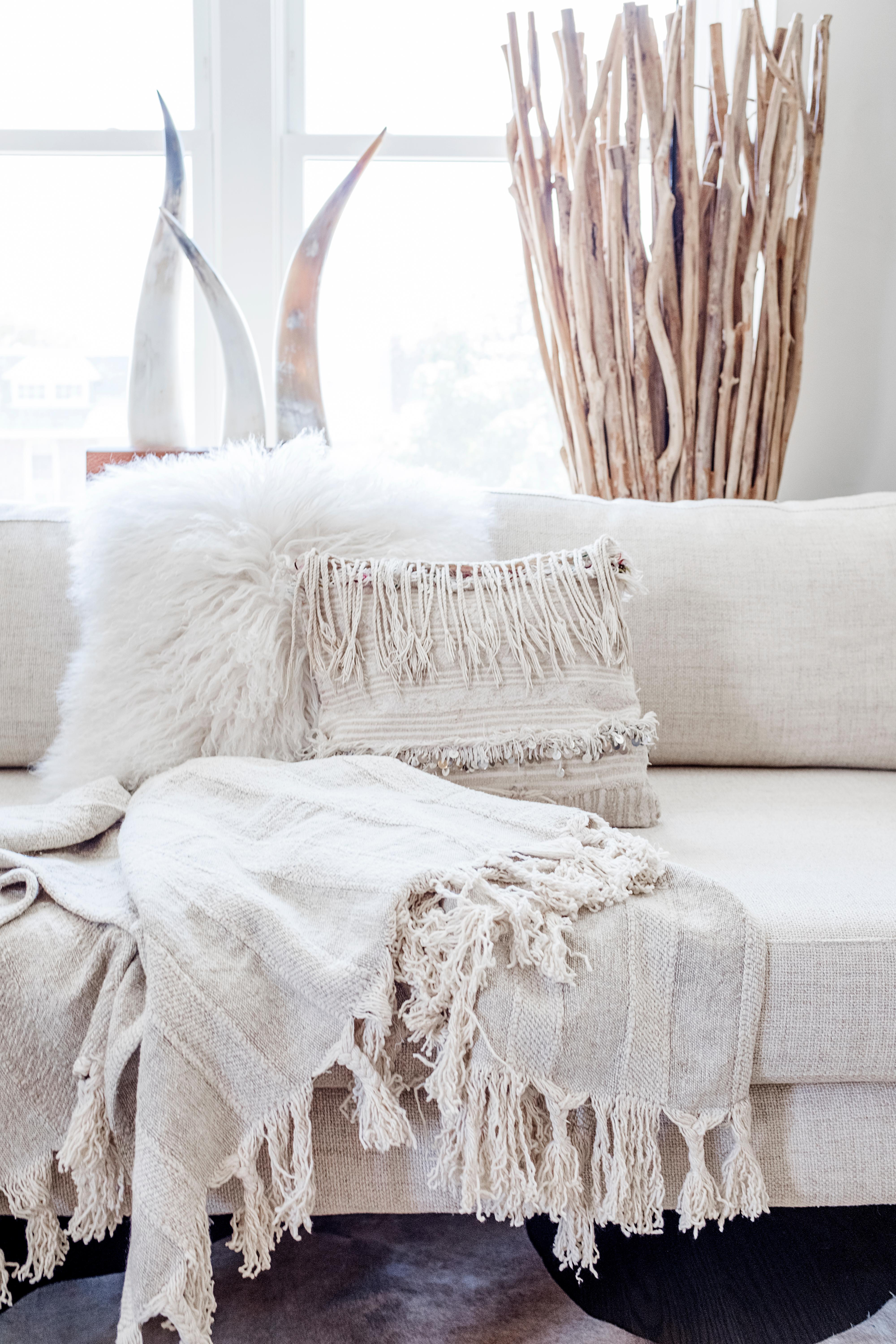 Winter is the perfect time to cozy up your couch, so  go wild with texture on both pillows and throws.(Image: Ashley Hafstead)