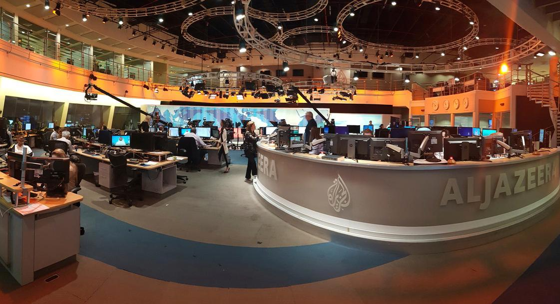 In this Thursday, June 8, 2017 photo, Al Jazeera staff work at their TV station in Doha, Qatar. The Arab news network Al-Jazeera has been thrust into the center of the story this week as Qatar came under virtual siege by its Gulf neighbors, pressuring it to shut down the TV channel that has infuriated them with its coverage for 20 years (AP Photo/Malak Harb)