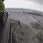 Big wave nearly washes storm watcher away