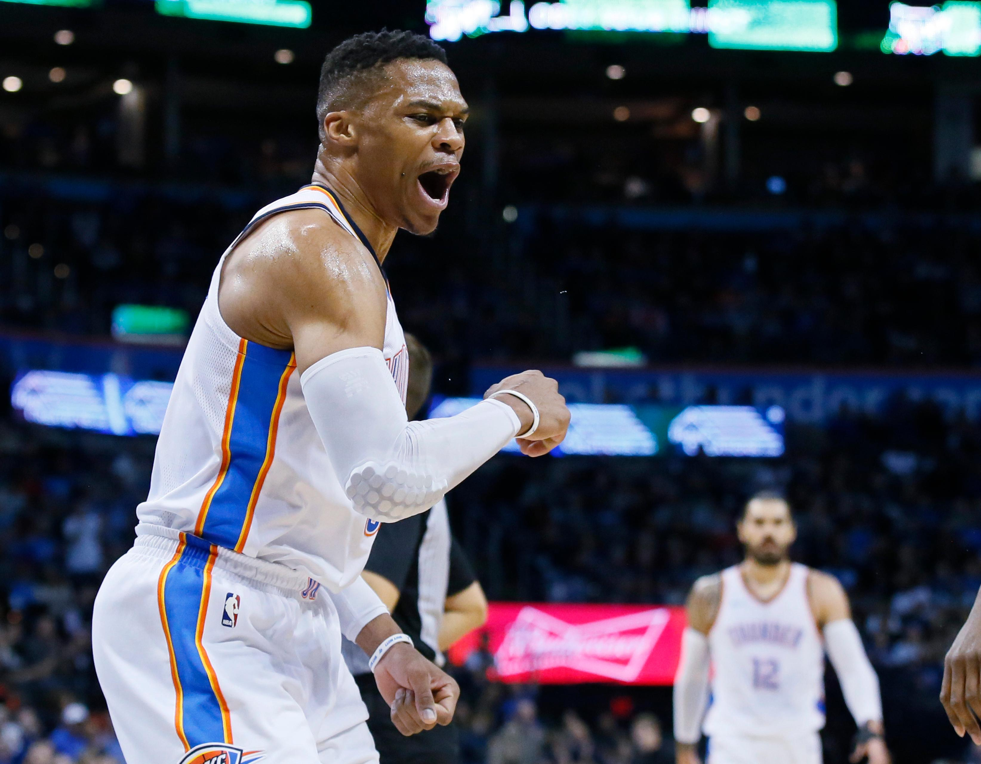 Oklahoma City Thunder guard Russell Westbrook celebrates after a basket by teammate Paul George during the first quarter of an NBA basketball game against the Minnesota Timberwolves in Oklahoma City, Friday, Dec. 1, 2017. (AP Photo/Sue Ogrocki)