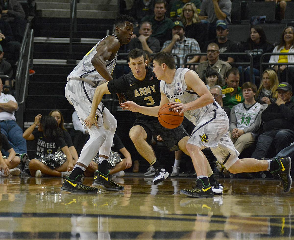 Ducks' Payton Pritchard (#3) looks to drive the ball past Army's Scott Mammel (#3). In front of a sold out crowd, Oregon defeated Army 91-77 on opening night. Photo by Jacob Smith, Oregon News Lab