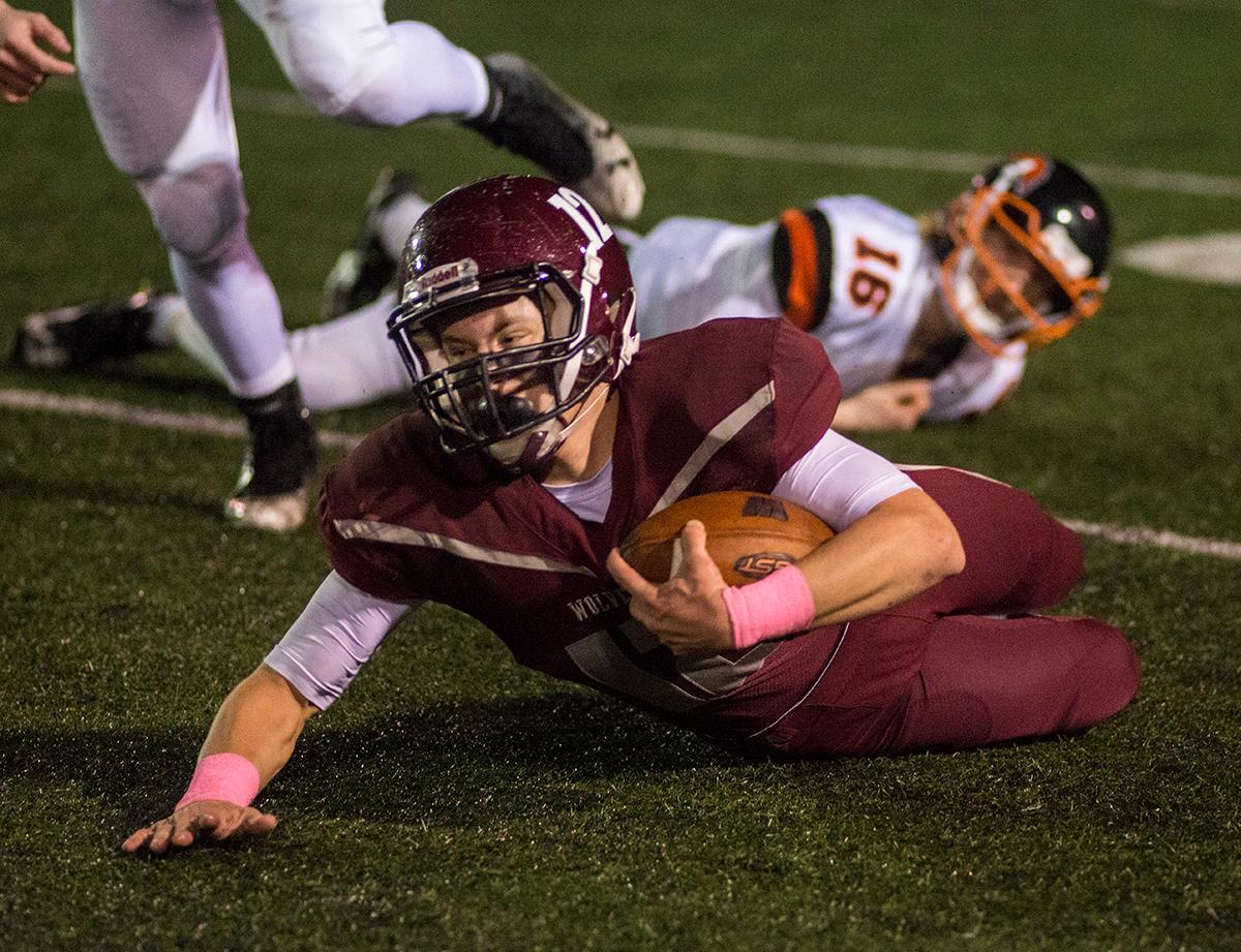 Willamette Wolverines Griffin LaVassaur (#12) attempts to gain as many yards as possible. Roseburg Indians defeated Willamette Wolverines 21-20 at Wolverine Stadium on Friday night in Eugene. Photo by Rhianna Gelhart, Oregon News Lab
