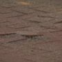 Repaired historic brick road not weathering the weather