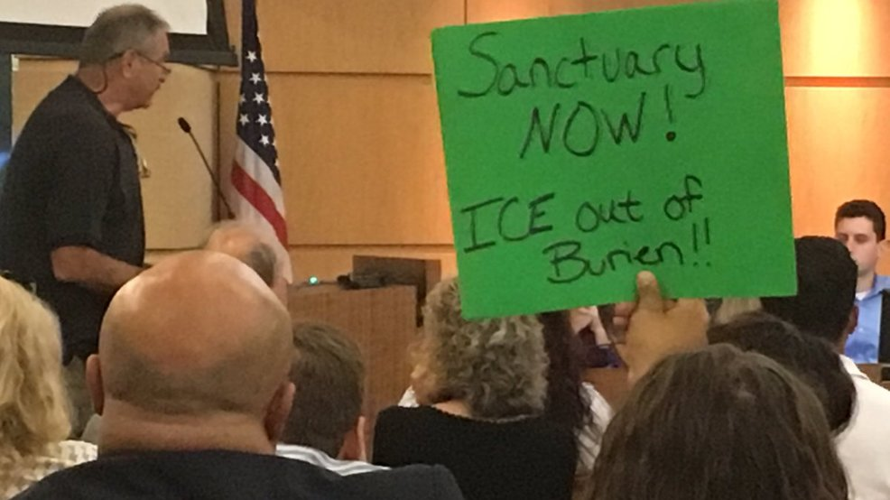 Sanctuary sign Burien city council 2017.jpg