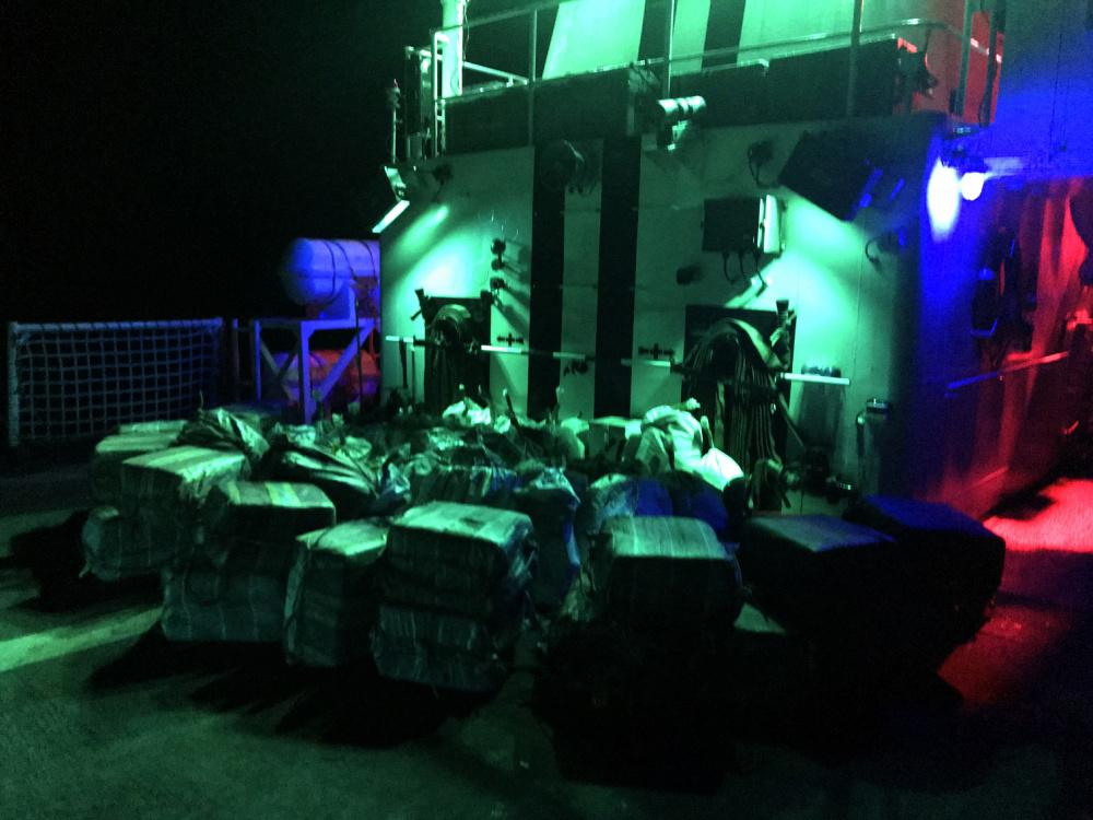 Bales of contraband lie stacked on the flight deck of the U.S. Coast Guard Cutter Steadfast. (Photo: U.S. Coast Guard)