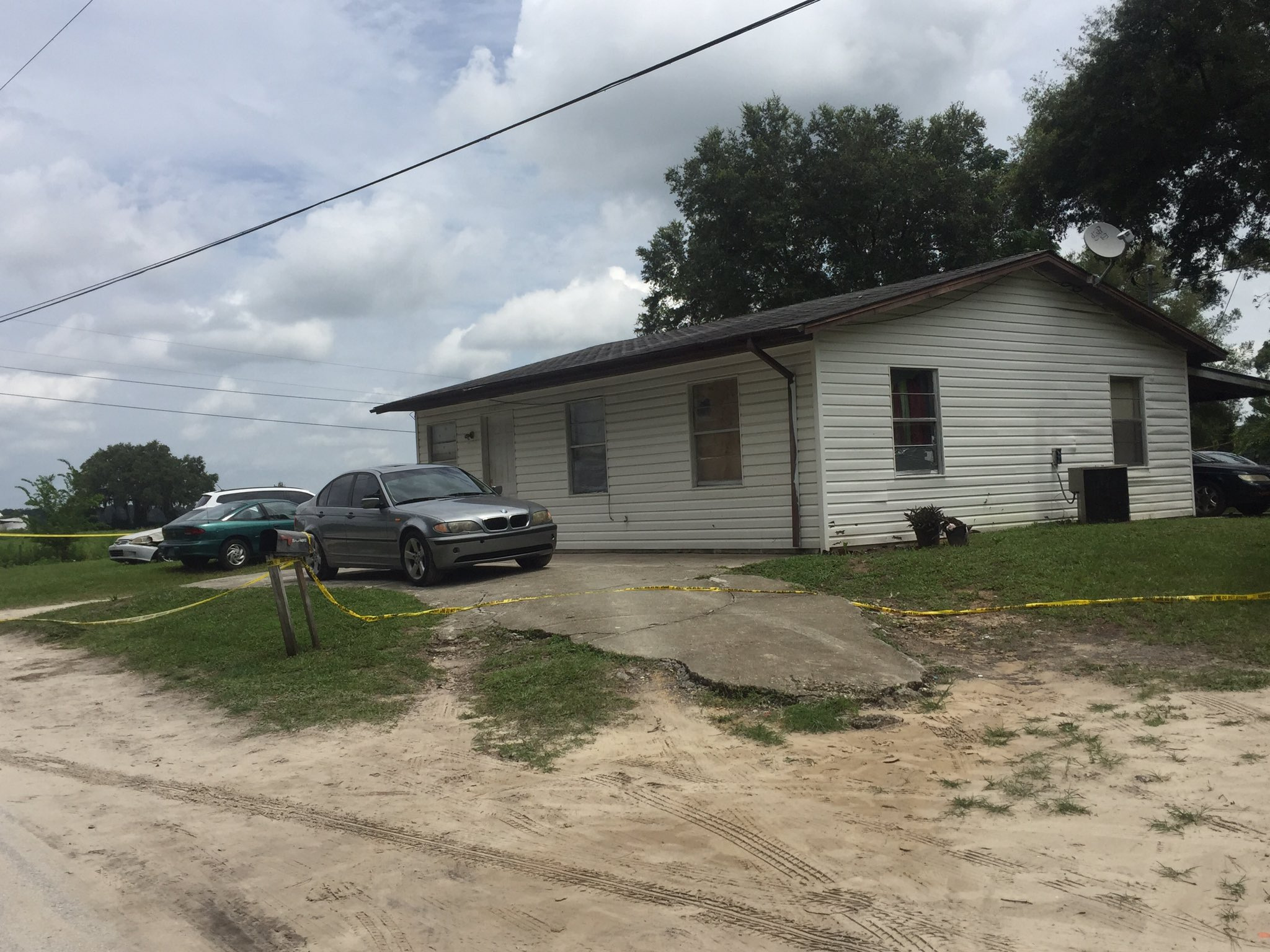 Two brothers were shot inside this house Friday night. Deputies made two arrests in the case Tuesday.