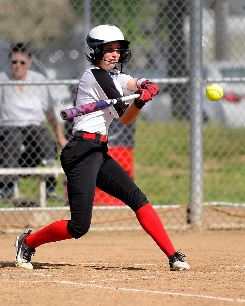 Andy Atkinson / Mail Tribune - North's Grace Johnson hits a double in the 3rd inning.