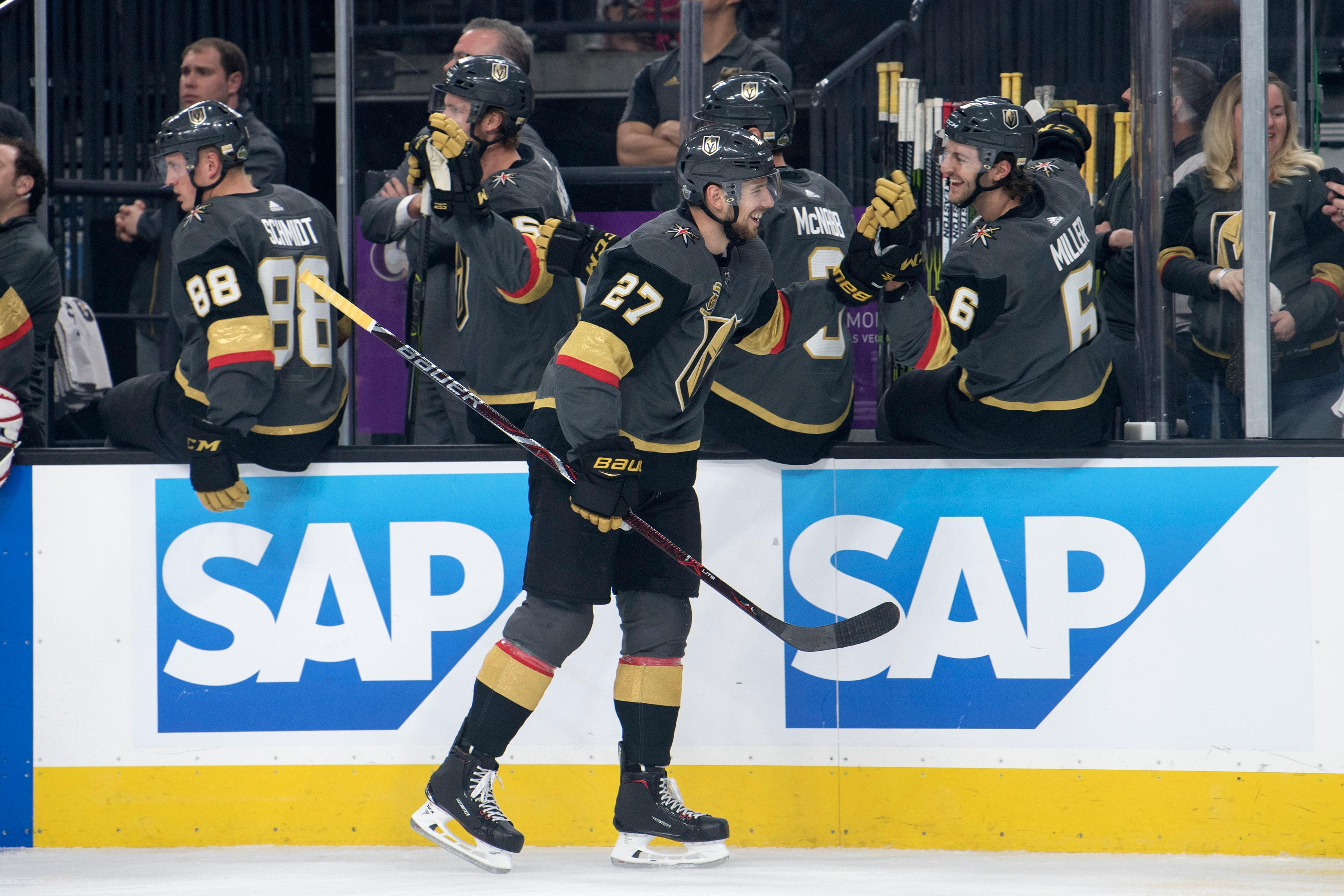 Vegas Golden Knights defenseman Shea Theodore (27) celebrates his goal against the Los Angeles Kings during the first period of Game 1 of their NHL hockey first-round playoff series Wednesday, April 11, 2018 at T-Mobile Arena. The Knights won 1-0. CREDIT: Sam Morris/Las Vegas News Bureau