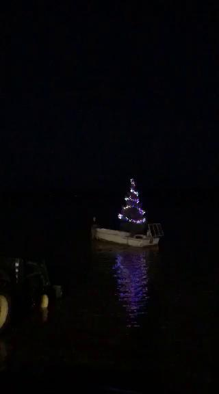 For the fourth year Glen Arbor resident, Frank Siepker Jr. has continued his family's holiday tradition of the Christmas tree boat that has become a staple in the community.  Thumbnail