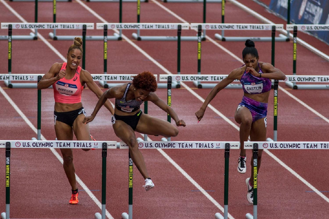 From left to right, Queen Harrison, Brianna Rollins, and Kristi Castlin leap over the final hurdle in the Women�s 100m Hurdle final. Harrison finished fourth with a time of 12.57. Rollins finished first with a time of 12.34. Castlin finished second with a time of 12.50. Kristi Castlin, left, and Nia Ali, right, embrace after realizing they qualified for the Rio Olympics in the Women�s 100m Hurdle. Castlin finished second with a time of 12.50. Ali finished third with a time of 12:55. Day eight of the U.S. Olympic Track and Field Trials took place Friday at Hayward Field in Eugene, Ore. Events continue through July 10. (Photo by Amanda Butt)