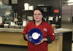 Maria Delgado holding the Blue Plate Award .jpg