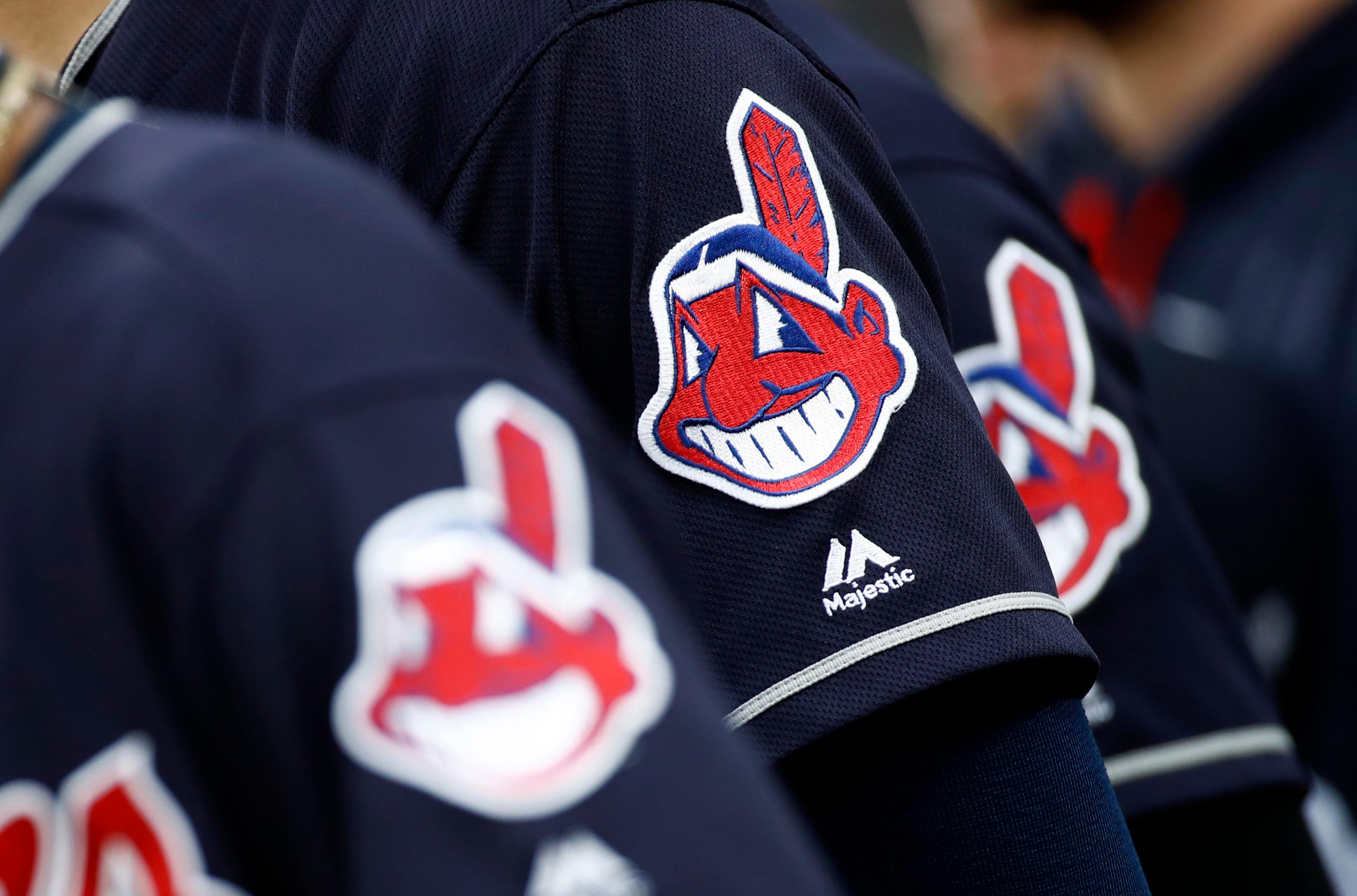 FILE -- In this June 19, 2017, file photo, members of the Cleveland Indians wear uniforms featuring mascot Chief Wahoo as they stand on the field for the national anthem before a baseball game against the Baltimore Orioles in Baltimore. (AP Photo/Patrick Semansky, File)