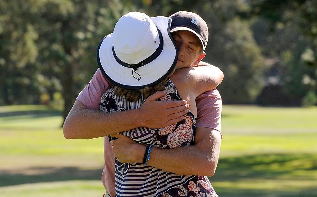 Andy Atkinson / Mail TribuneMatt Hedges gets a hug from his mother Susie after closing the championship match on the 9th green.