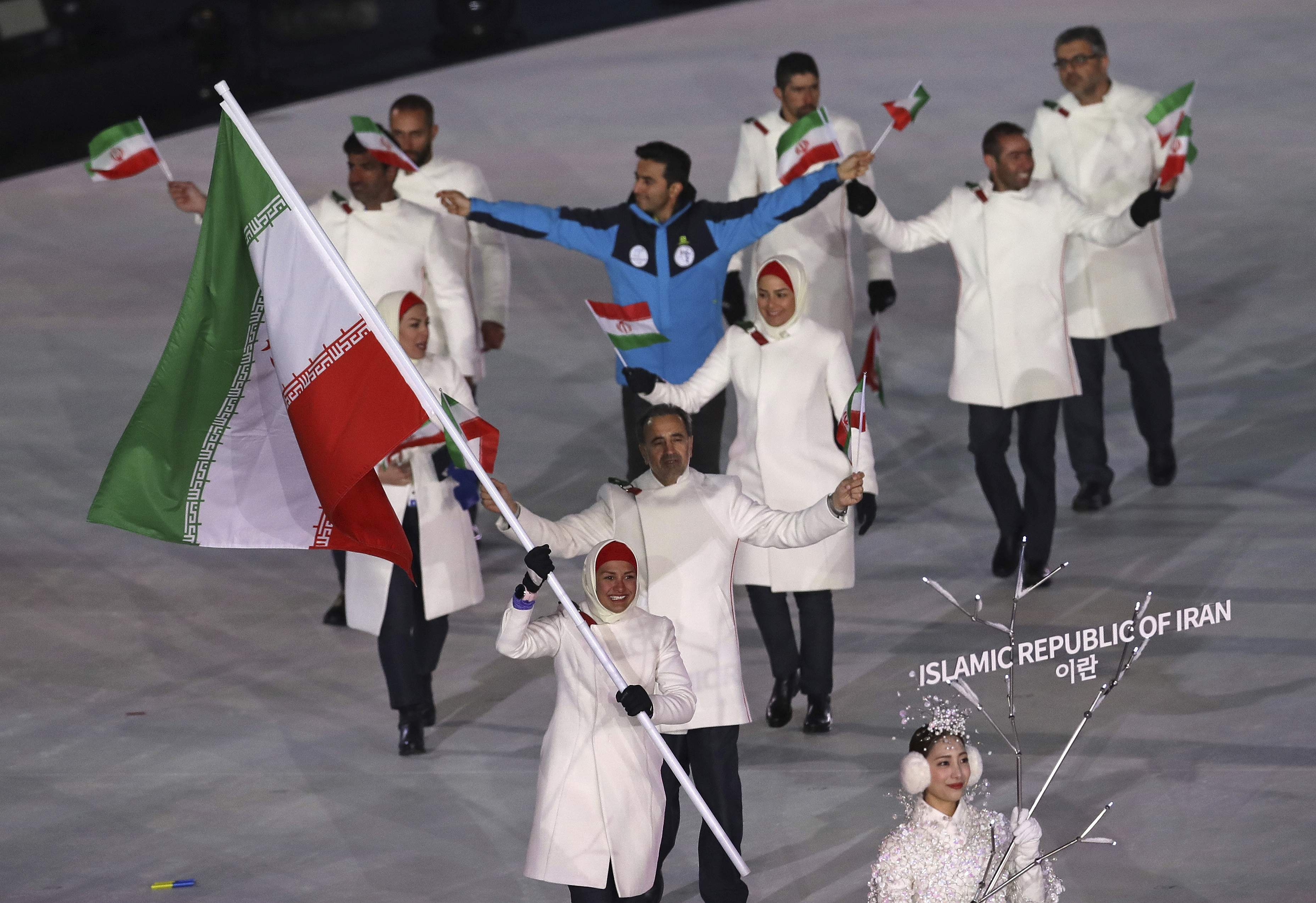 Samaneh Beyrami Baher carries the flag of Iran during the opening ceremony of the 2018 Winter Olympics in Pyeongchang, South Korea, Friday, Feb. 9, 2018. (AP Photo/Michael Sohn)