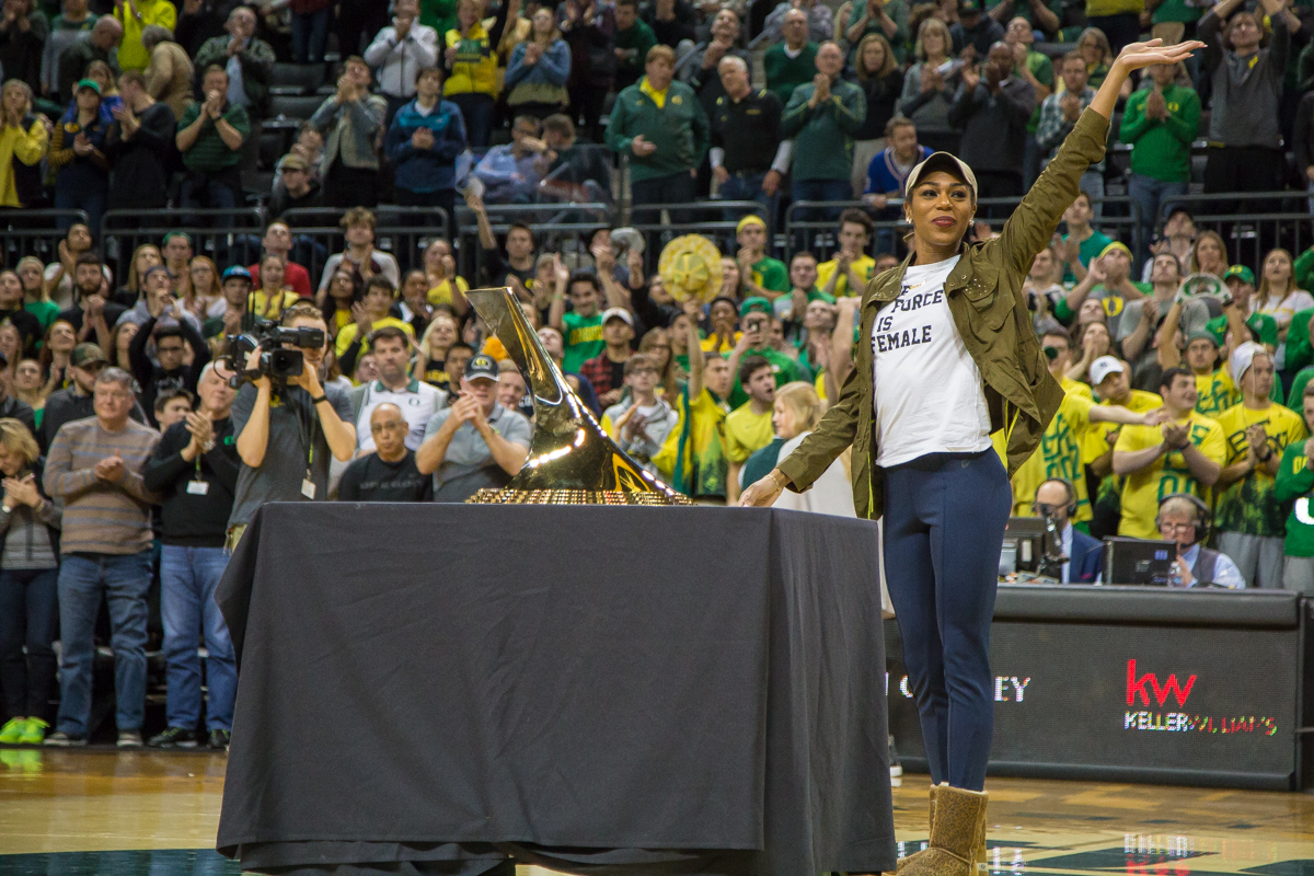 Former Oregon track athlete Raevyn Rogers is honored during a timeout along side the Bowerman trophy she won earlier this year. The Oregon Ducks men's basketball team defeated the UCLA Bruins 94-91 Saturday night in front of a home crowd at Matthew Knight Arena. The win brings the Ducks 13-7 overall for the season and 3-4 in Pac-12 play. Photo by Dillon Vibes