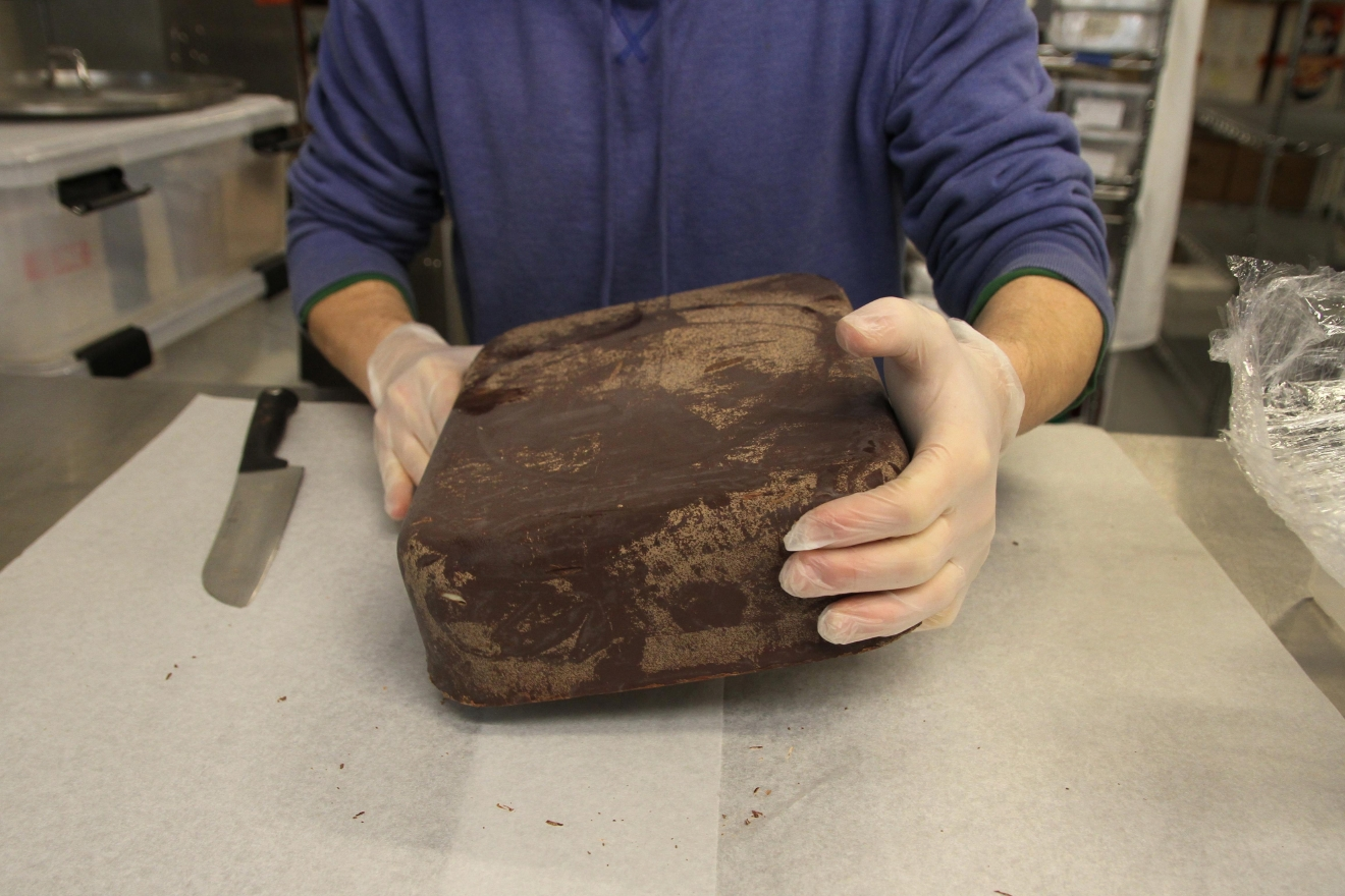 Since the chocolate hasn't been tempered, there are rivulets of cacao butter inside the block. (Image: Amanda Andrade-Rhoades/ DC Refined)