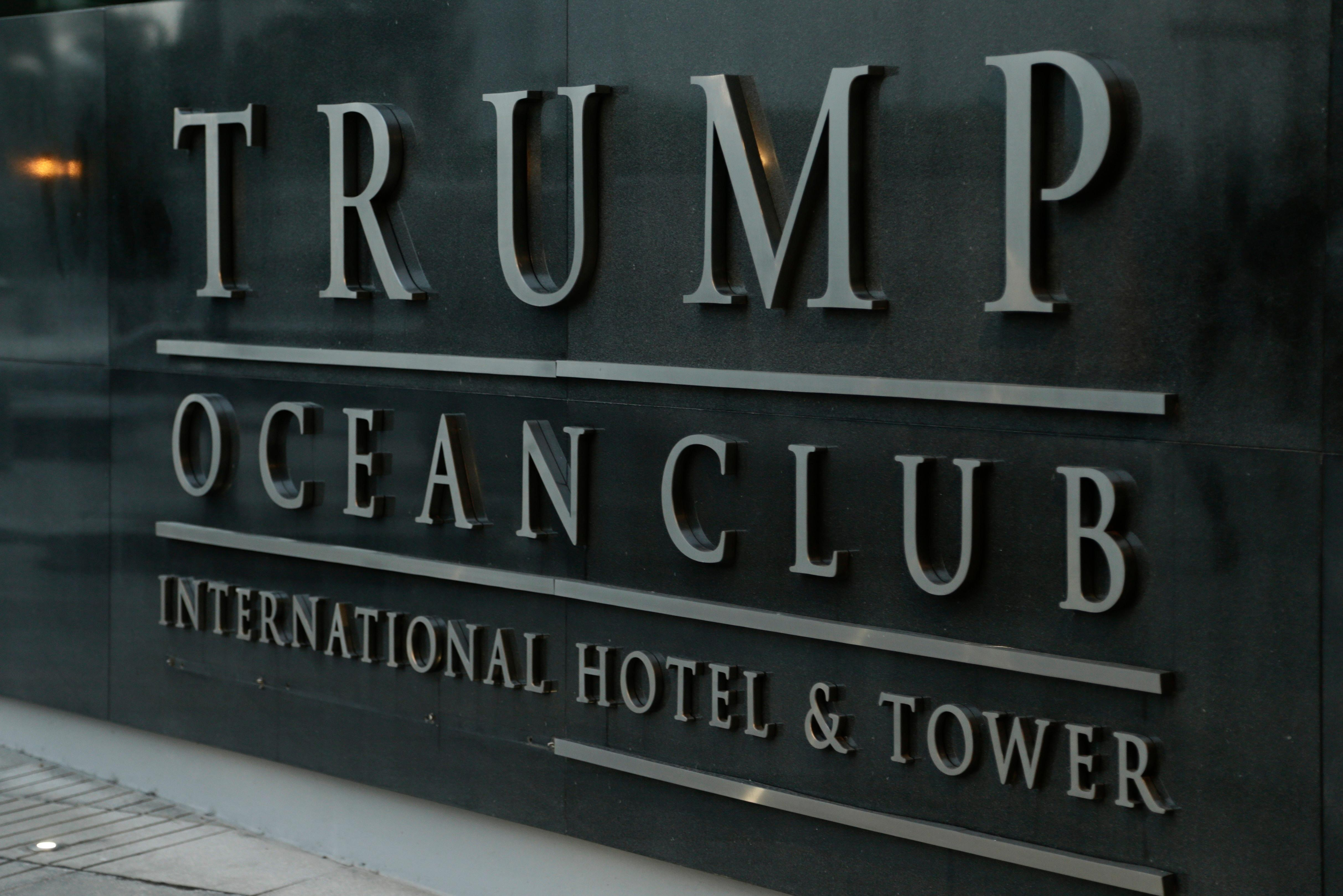 A marquee of the main entrance to the Trump Ocean Club International Hotel and Tower is seen in Panama City, Friday, Feb. 23, 2018. One of President Donald Trump's family businesses is battling an effort to physically evict its team of executives from a luxury hotel in Panama where they manage operations, and police have been called to keep the peace, The Associated Press has learned. Witnesses told the AP they saw Trump's executives carrying files to a room for shredding. (AP Photo/Arnulfo Franco)