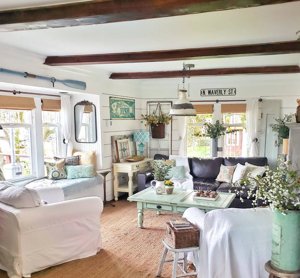The remodeled living room of Robinson's home is pure beach cottage chic. (Photo: Kim Robinson/Shiplap and Shells)<p></p>