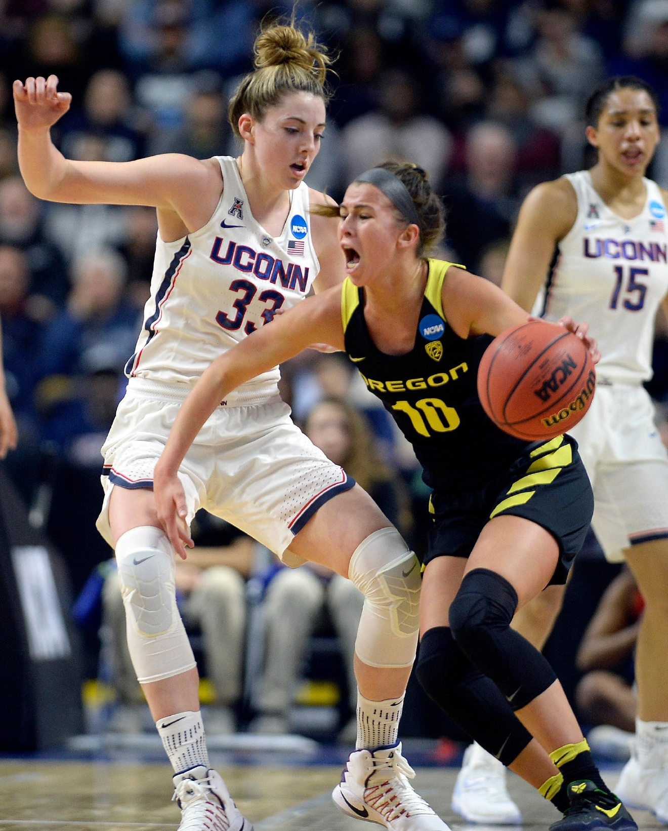 Connecticut's Katie Lou Samuelson, left, defends against Oregon's Lexi Bando, right, during the first half of a regional final game in the NCAA women's college basketball tournament, Monday, March 27, 2017, in Bridgeport, Conn. (AP Photo/Jessica Hill)