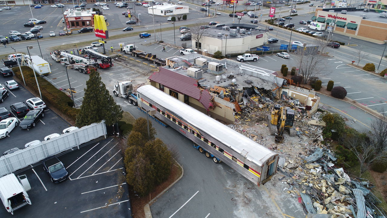 A railroad passenger car is removed from a McDonald's restaurant in Fall River, Monday, March 12, 2018. (Tom Byrne photo)