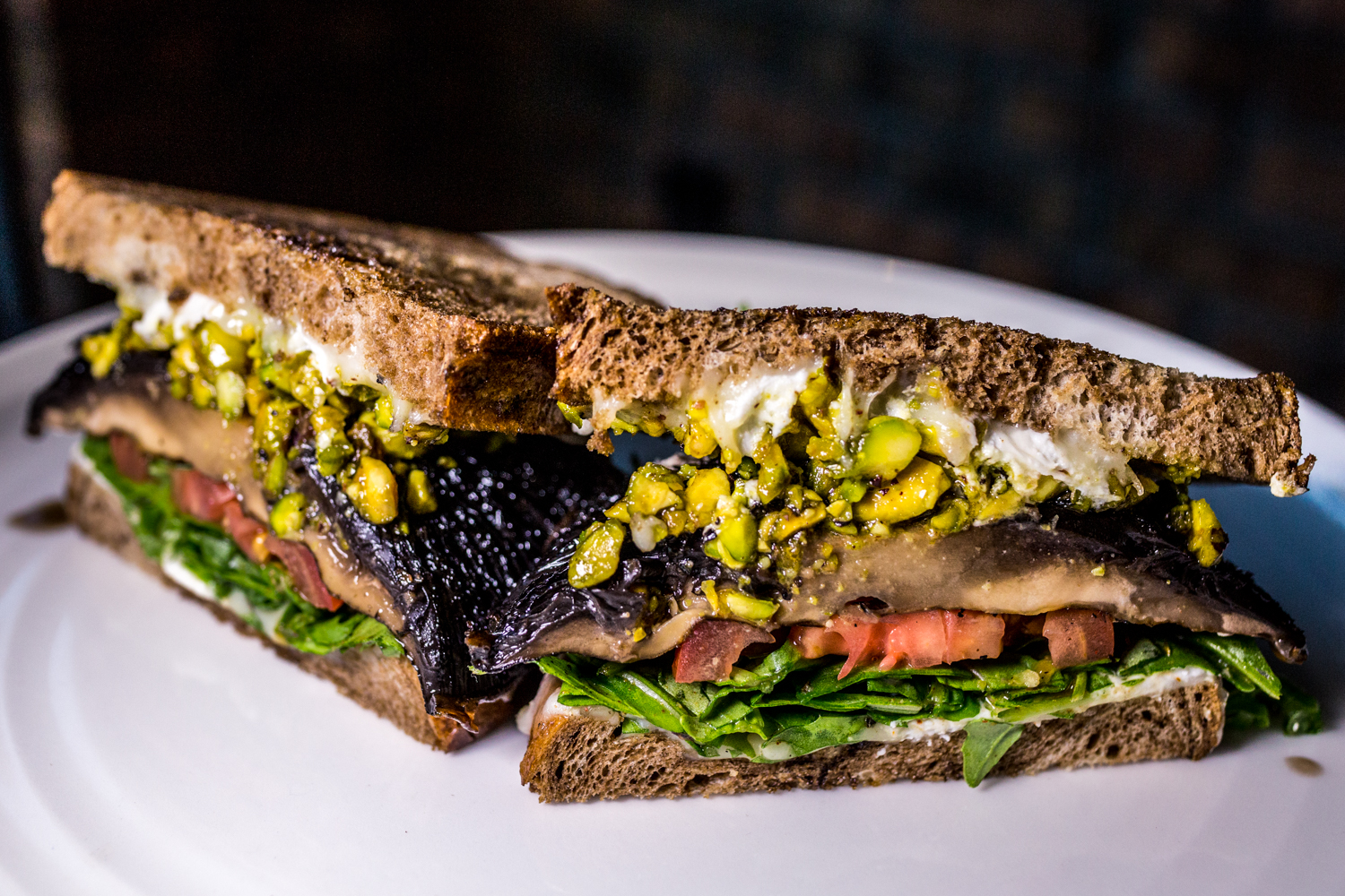 Portabella Melt: over roasted portabella mushroom on local grilled rye with arugula, Roma tomato slices, tangy goat cheese, parlor blend cheese, and pistachio pesto / Image: Catherine Viox{ }// Published: 10.10.19