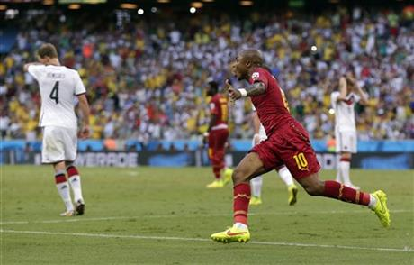 Ghana's Andre Ayew celebrates after scoring his sides' first goal during the group G World Cup soccer match between Germany and Ghana at the Arena Castelao in Fortaleza, Brazil, Saturday, June 21, 2014.