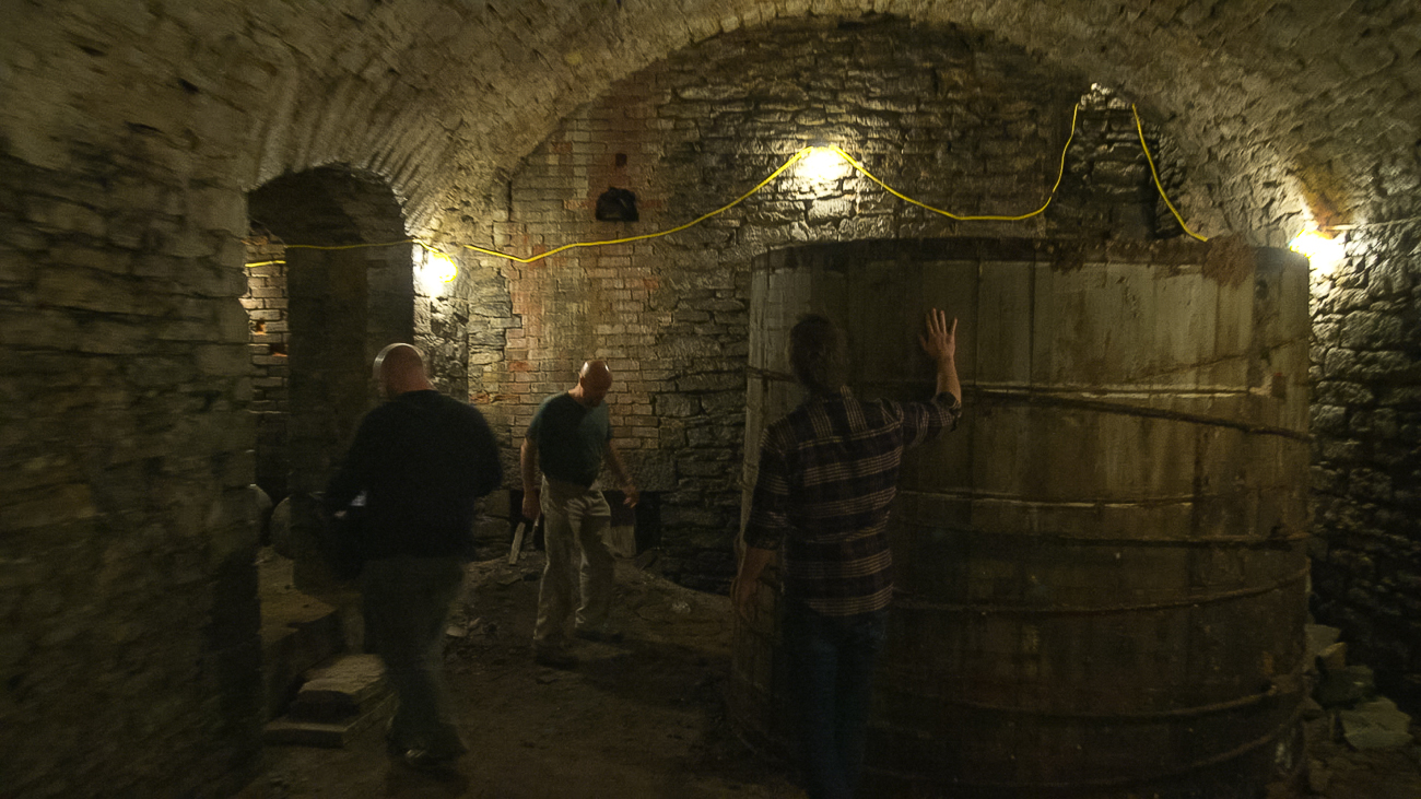 Urban Artifact's Josh Elliott and Bret Kollmann Baker flank beer historian Mike Morgan in a former lagering cellar that was recently discovered in Over-the-Rhine. / Image courtesy of{ }Seven/Seventy-Nine Video // Published: 11.5.18