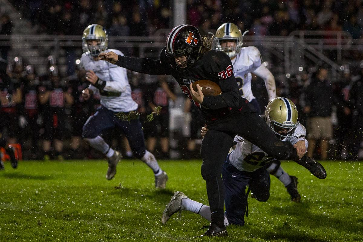 Thurston Colts running back Wes Kommer (#36) attempts to shake Marist's defense. The Thurston Colts defeated the Marist Catholic Spartans 50 – 14 to seal second place in their conference at Thurston High School on Friday, October 13. Photo by Kit MacAvoy, Oregon News Lab