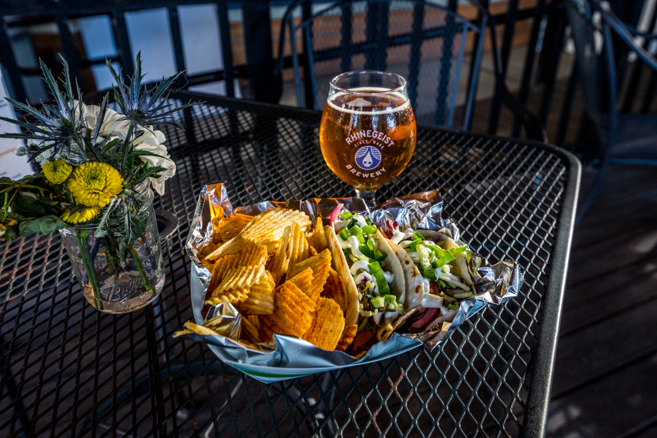 Chips and pulled pork tacos with a Rhinegeist beer / Image: Catherine Viox // Published: 7.19.19