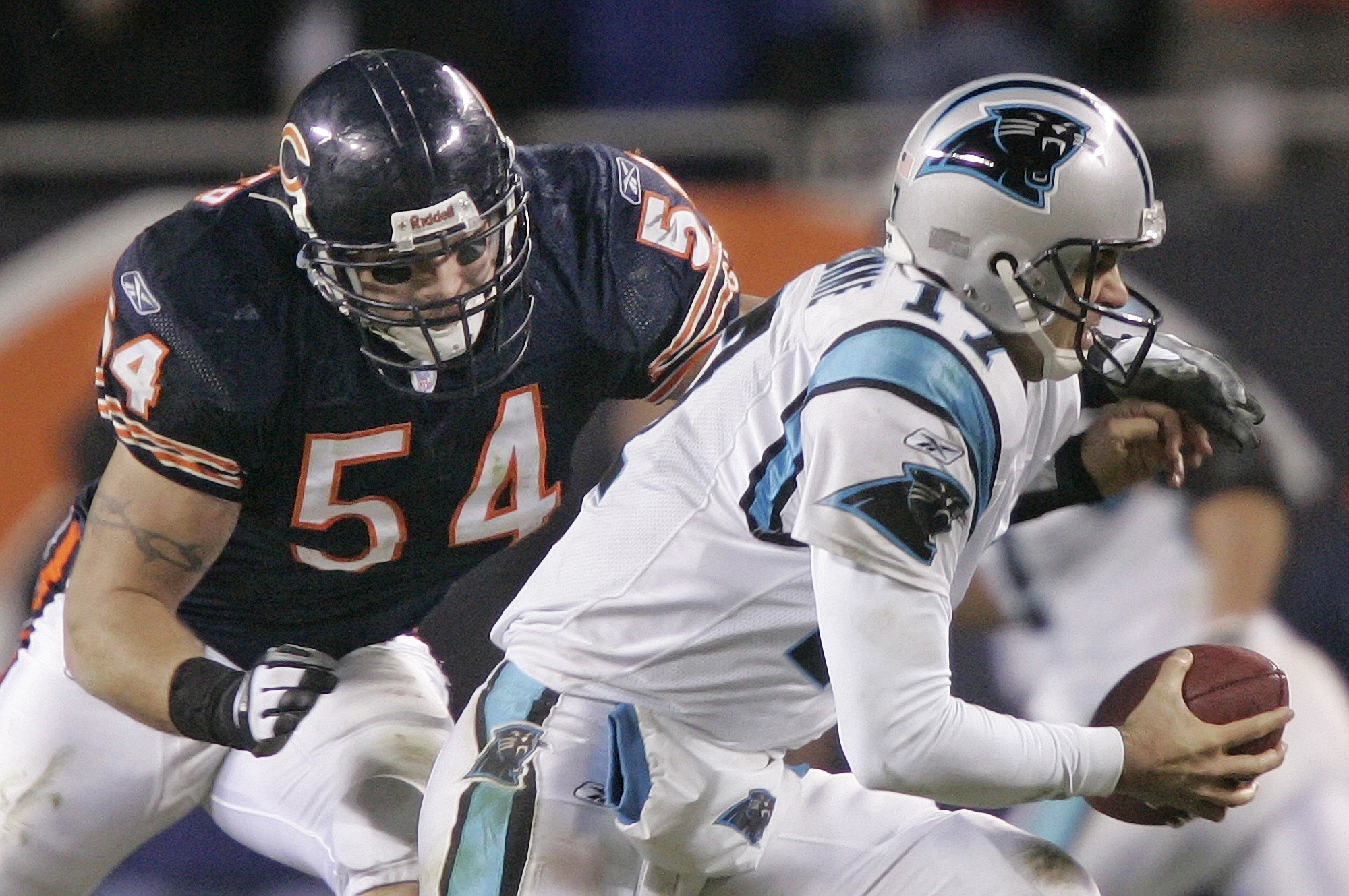 FILE - In this Jan. 15, 2006, file photo, Chicago Bears' linebacker Brian Urlacher (54) attempts to sack Carolina Panthers' quarterback Jake Delhomme (17) in the third quarter of their NFC divisional playoff football game in Chicago. Urlacher was elected to the Pro Football Hall of Fame on Saturday, Feb. 3, 2018. (AP Photo/Morry Gash, File)