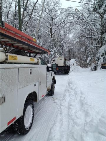 Utility crews deal with harsh conditions as they repaired lines Sunday night.