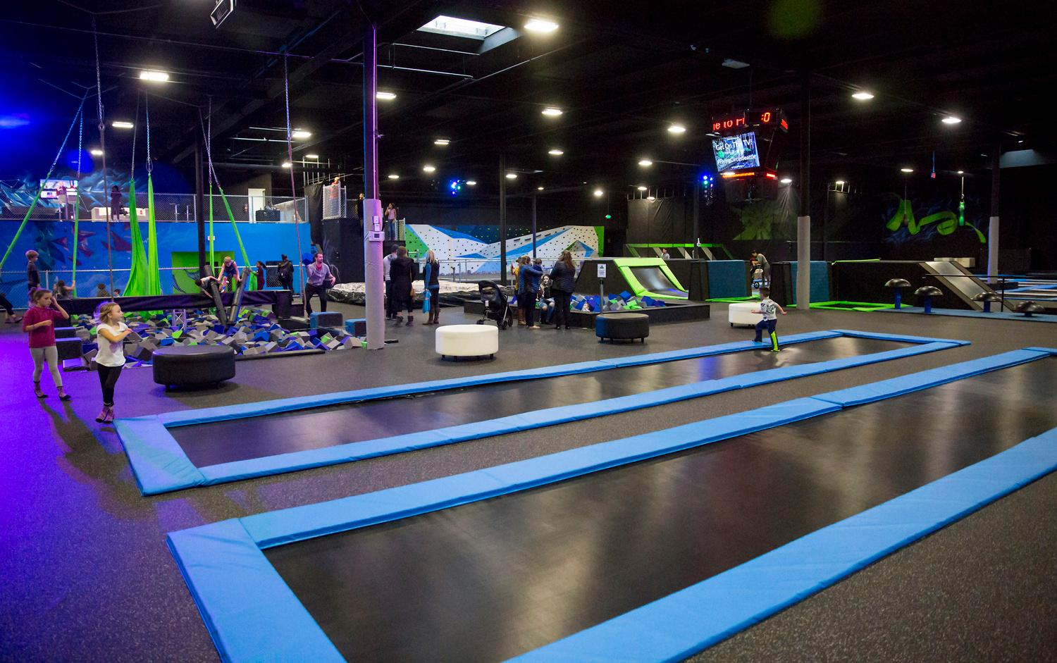 Flying Circus is the world's largest extreme air sports park, located at 455 Andover Park E, Tukwila. Activities include a ninja obstacle course, extreme dodgeball, slacklines, rock climbing wall over a foam pit, and aerial silks. (Sy Bean / Seattle Refined)