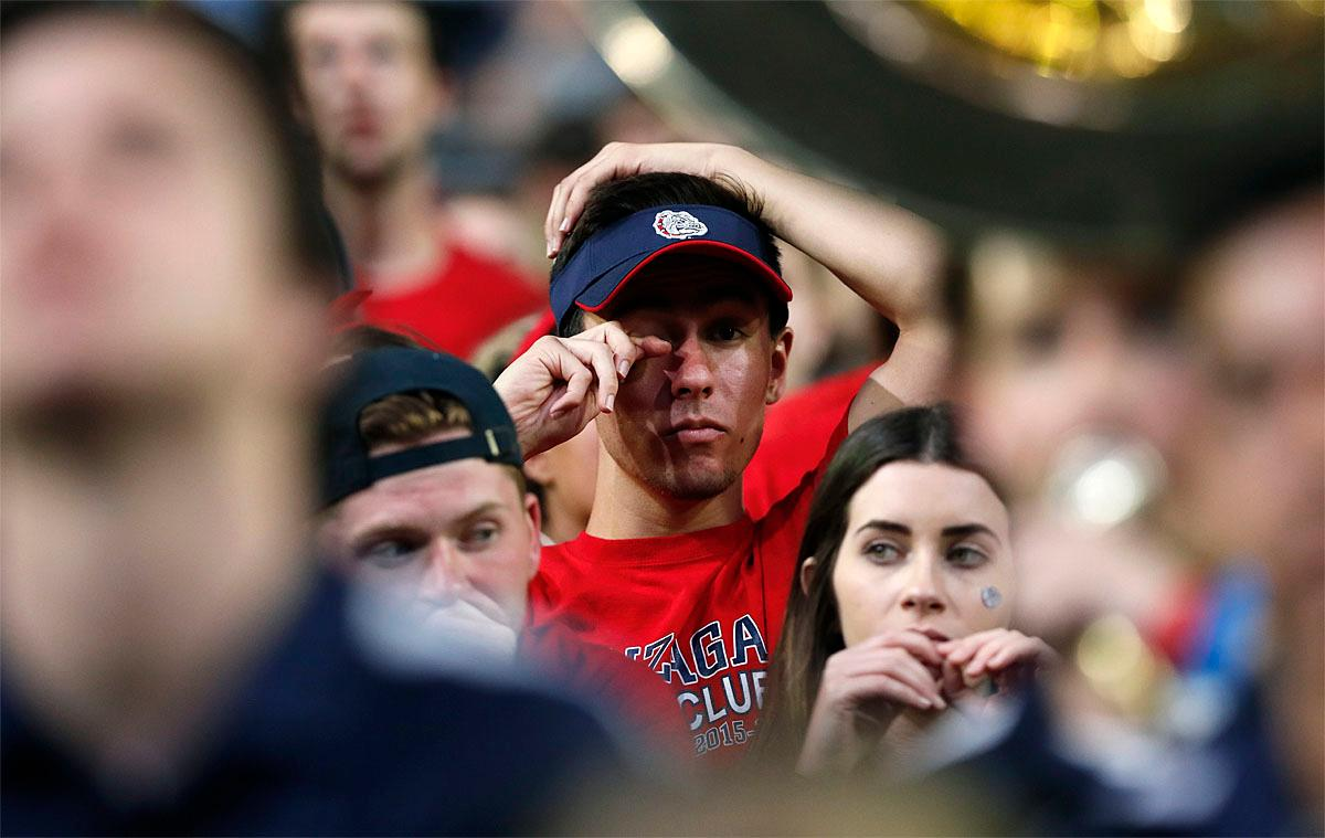 A Gonzaga fan reacts at the end of the championship game against North Carolina at the Final Four NCAA college basketball tournament, Monday, April 3, 2017, in Glendale, Ariz. North Carolina 71-65. (AP Photo/Charlie Neibergall)