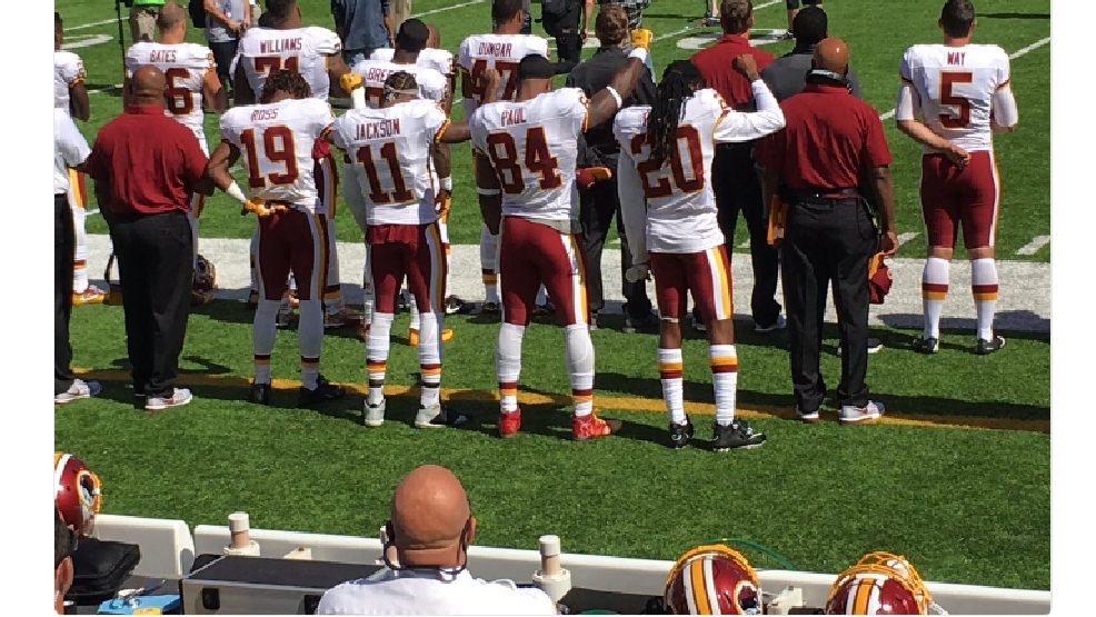 Redskins players raise fists during national anthem | WJLA