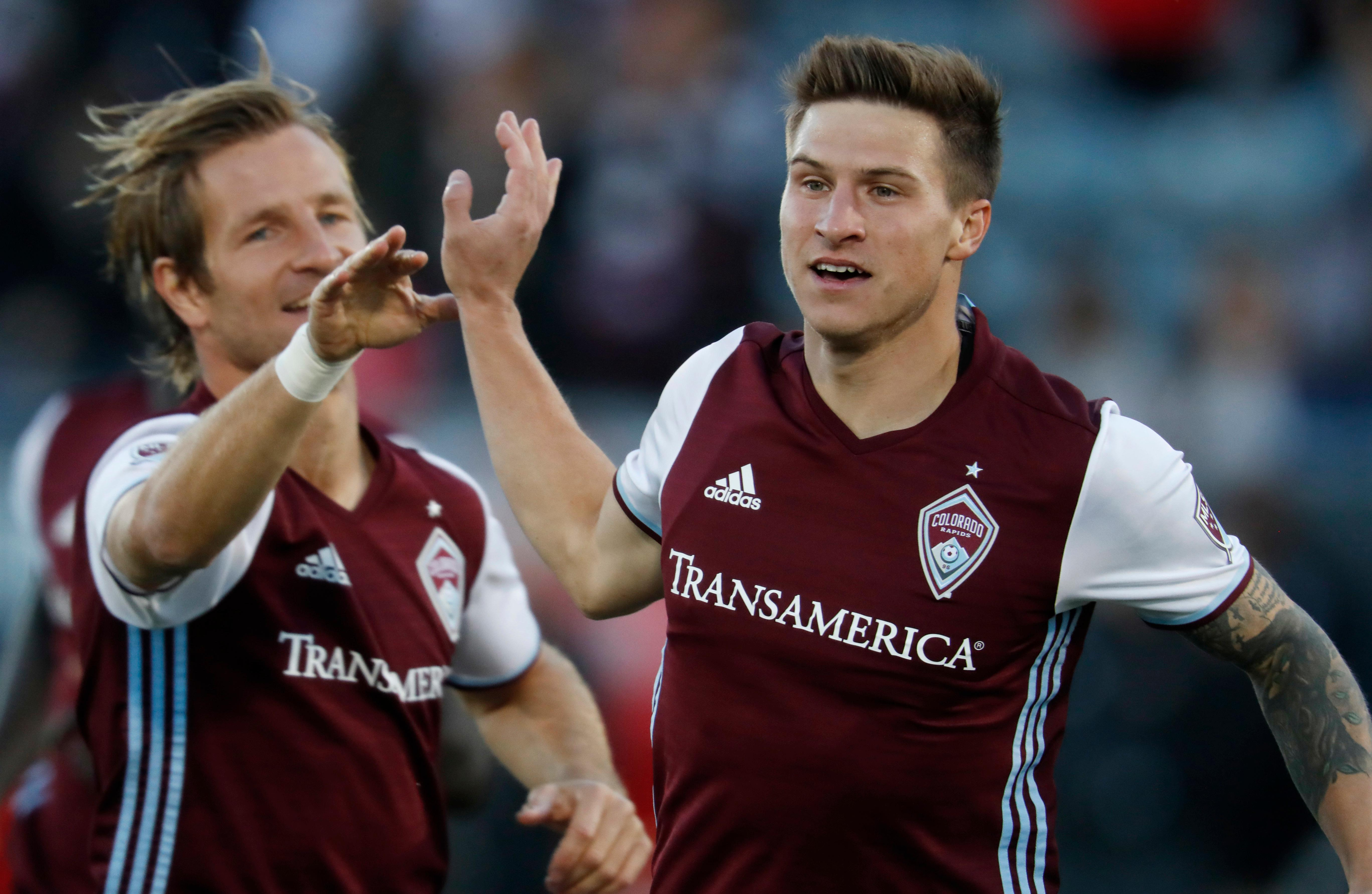 Colorado Rapids midfielder Stefan Aigner, left, congratulates midfielder Joshua Gatt after his goal against Real Salt Lake early in the first half of an MLS soccer match, Sunday, Oct. 15, 2017, in Commerce City, Colo. (AP Photo/David Zalubowski)