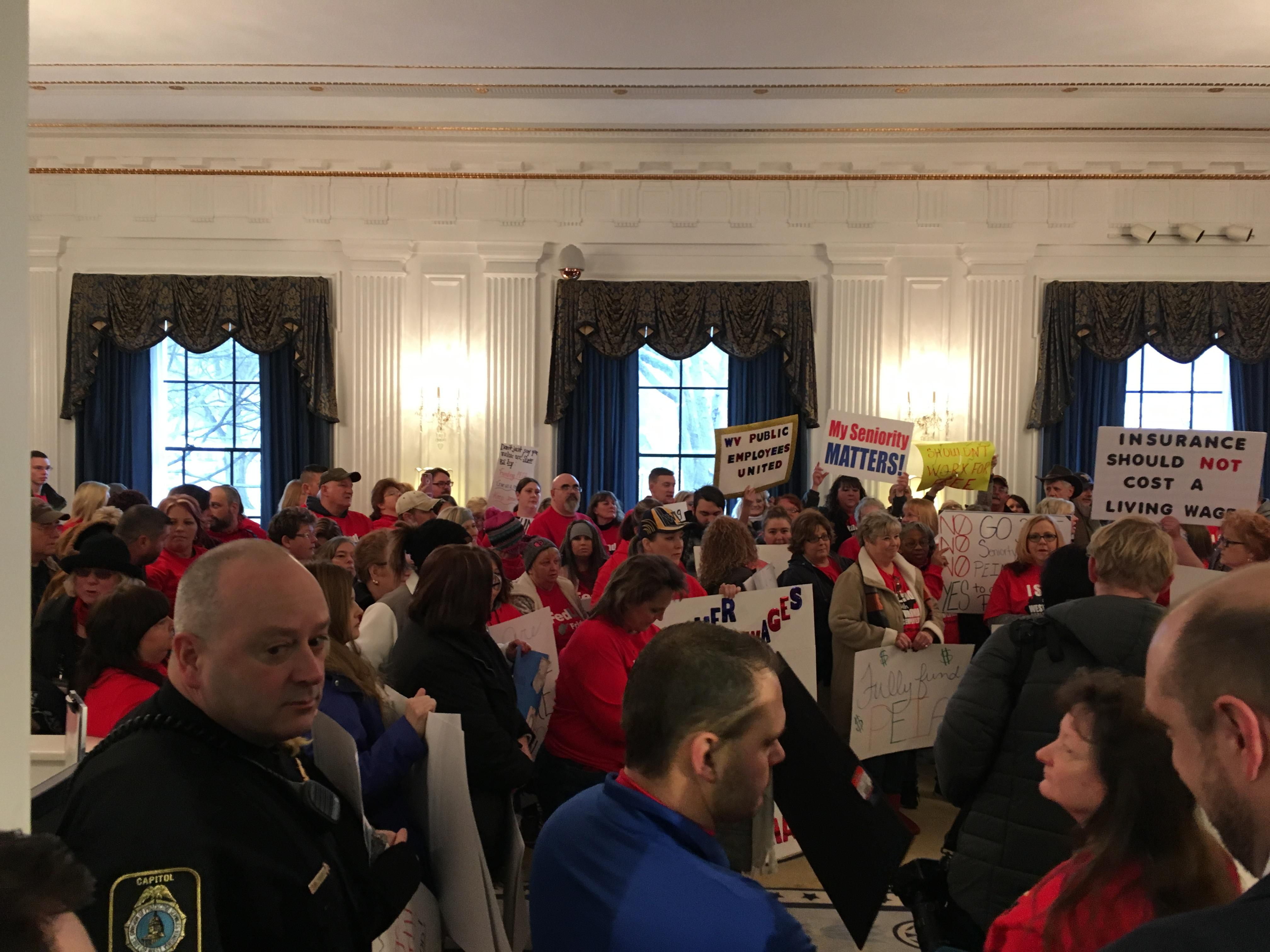 Teachers crowd into West Virginia Gov. Jim Justice's office at the West Virginia Capitol Friday to protest pay and health insurance. (WCHS/WVAH)<p></p>