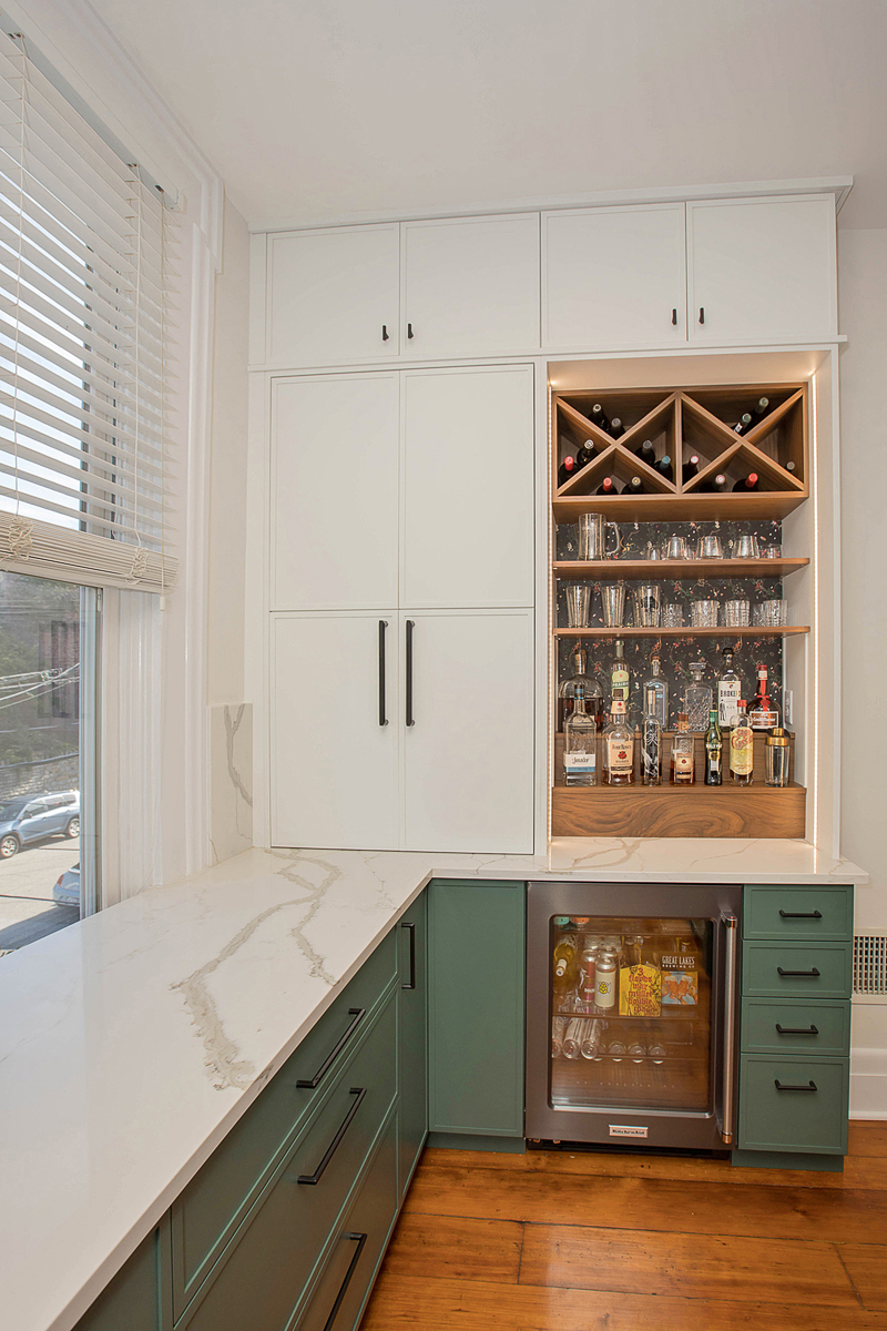The cabinets on either side of the kitchen are tall and provide ample storage. / Image courtesy of Neal's Design Remodel // Published: 11.1.20