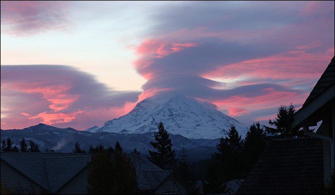 Sun rises behind Mt. Rainier on Nov. 22, 2012. (Photo: Ryan Verwest)