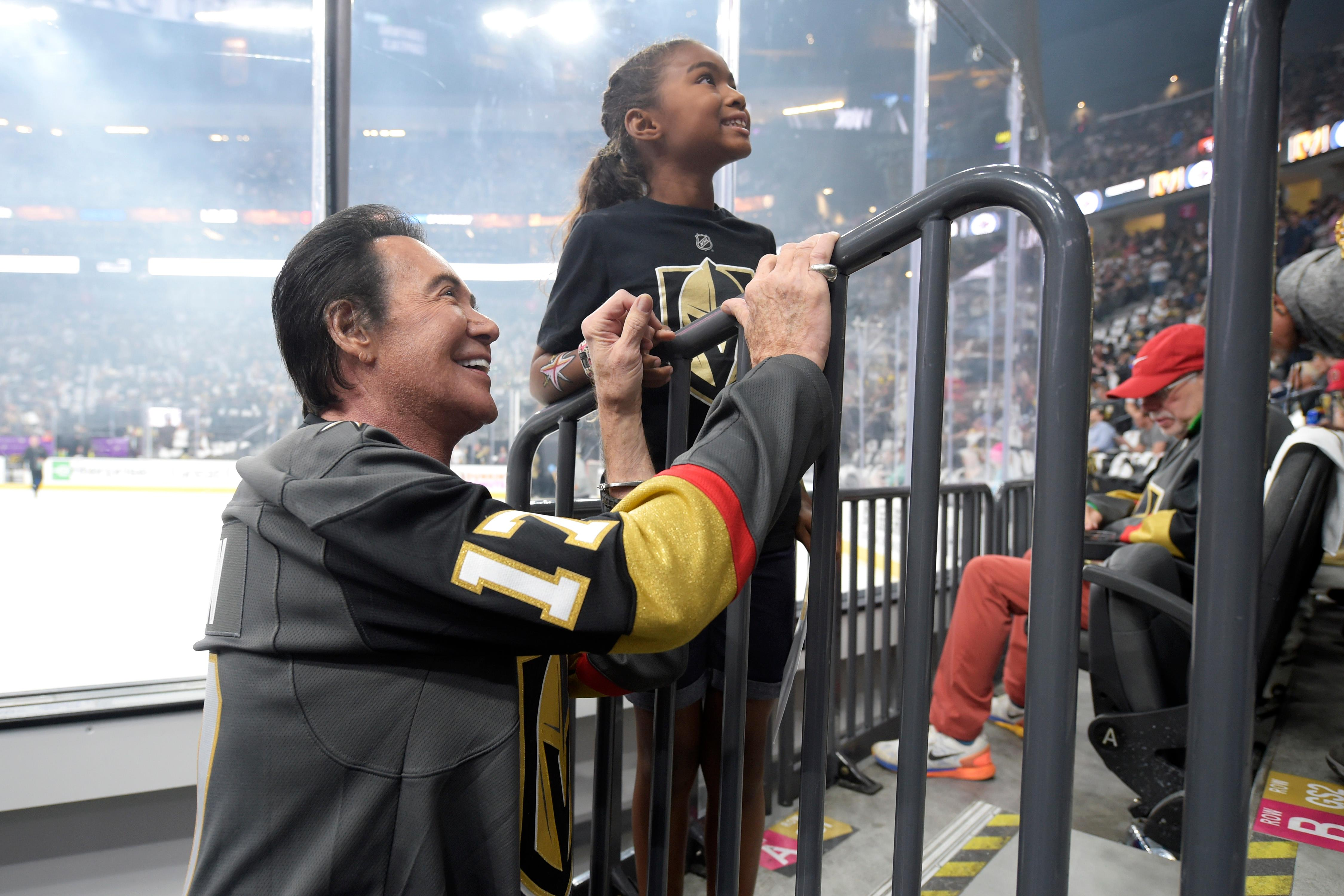 Wayne Newton poses for a photo with a young Vegas Golden Knights fan before Game 4 of their NHL hockey Western Conference Final game against the Winnipeg Jets Friday, May 18, 2018, at T-Mobile Arena. CREDIT: Sam Morris/Las Vegas News Bureau