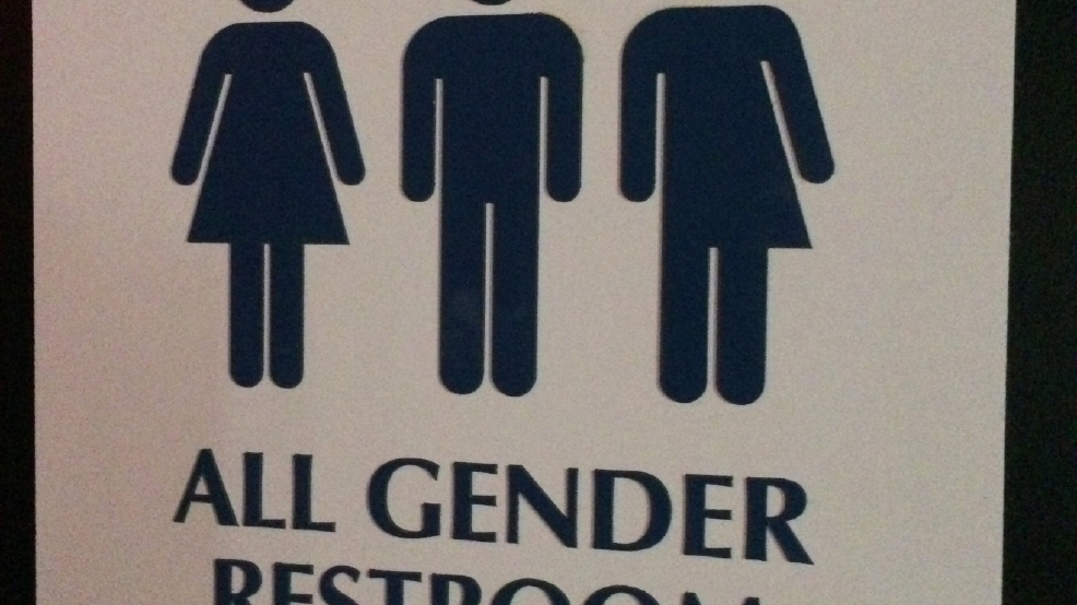 this may 11 2014 photo shows an all gender restroom sign outside a bathroom in a bar in washington confrontations have flared across the country over - All Gender Bathroom Sign
