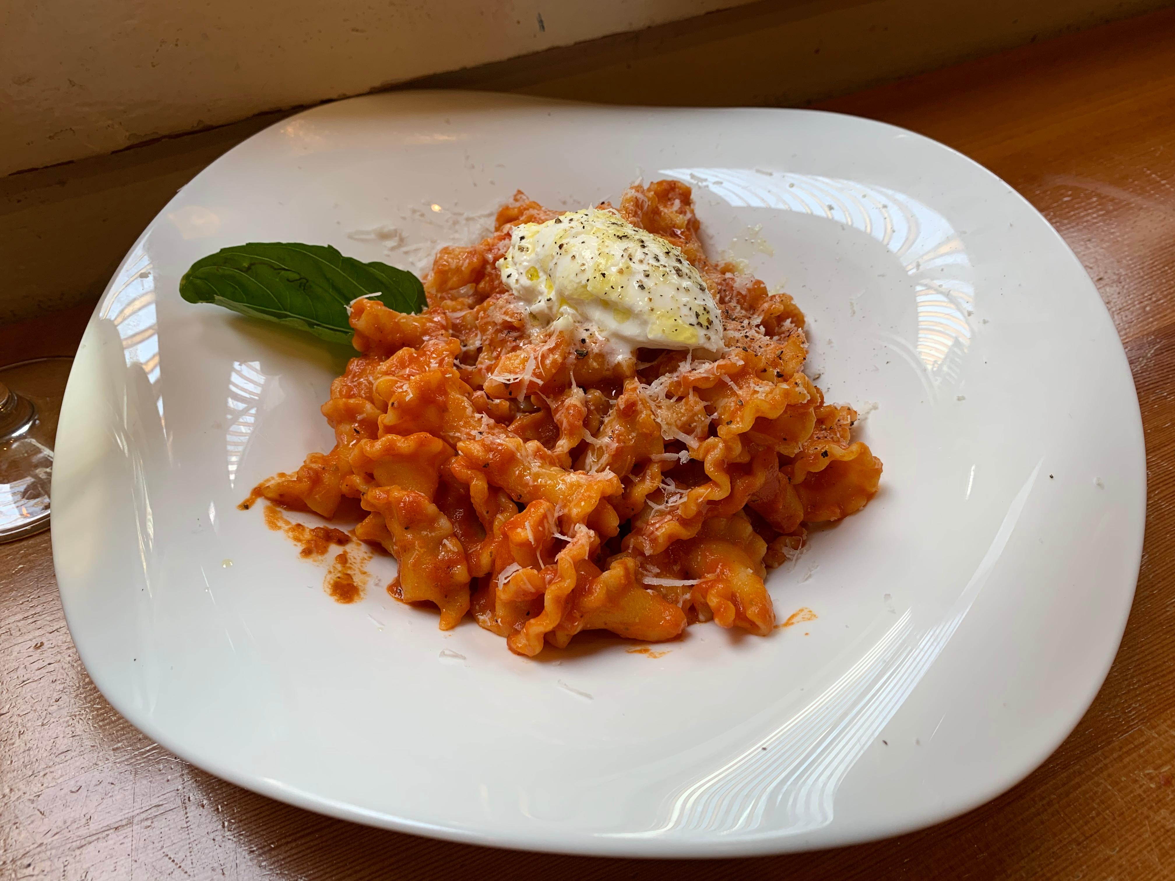 Campanella in pomodoro sauce with a hit of burrata at Pasta Casalinga. (Image: Frank Guanco)