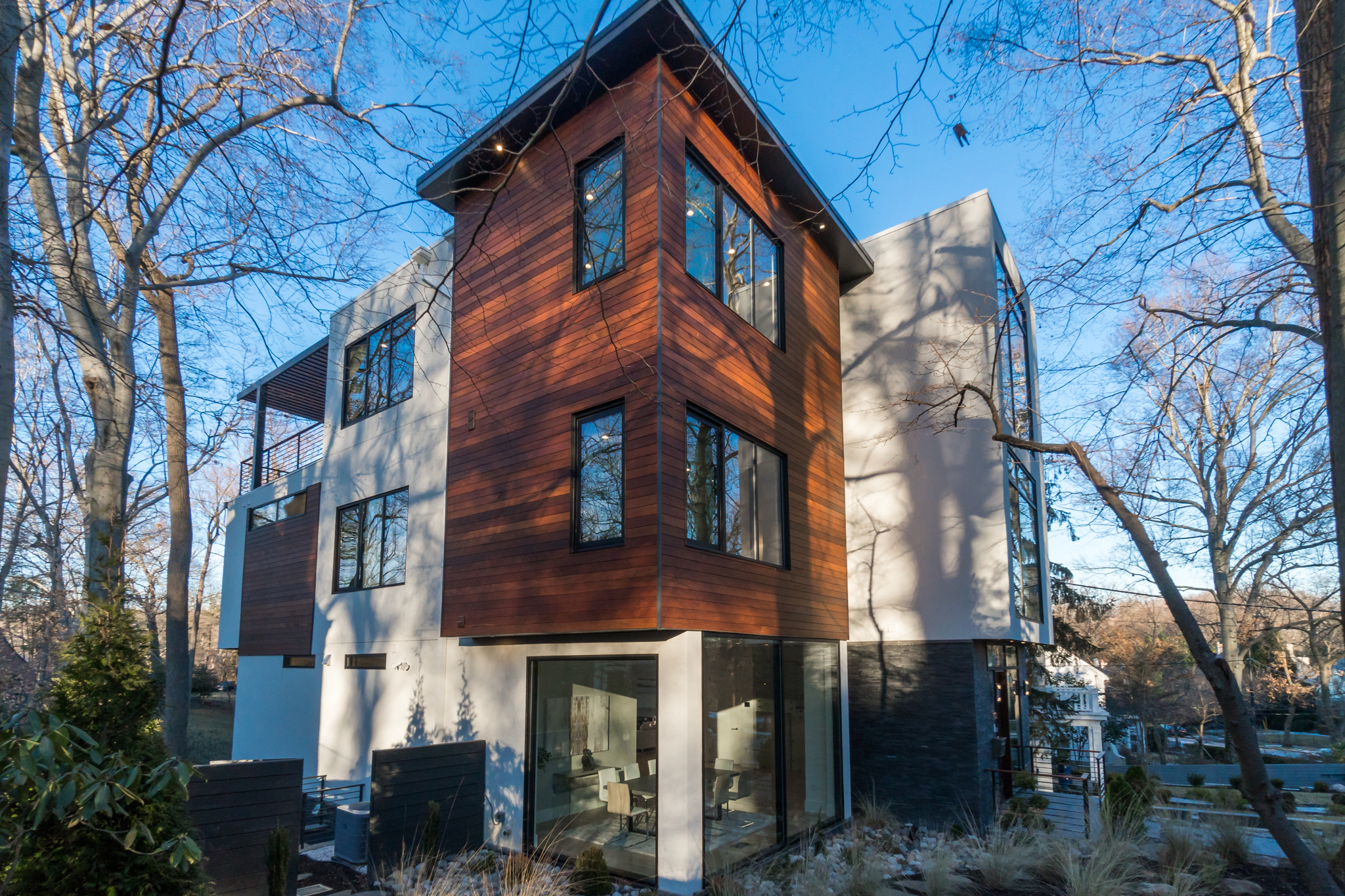 This modern four-story home in Forest Hills just hit the market and we admit... we have house envy! Built in 2018, the 7,300-square-foot property has six bedrooms, five full bathrooms, one half bath, two fireplaces, a finished basement (with a rec room, sauna and wine cellar), a heated outdoor pool and a two-car garage. The floor-to-ceiling windows throughout the home give off a &quot;treehouse-like&quot; vibe and offer unobstructed views of Rock Creek Park, plus lots of natural light. The current asking price is $3,875,000. For more information, you can see the full listing here (http://bit.ly/2DPbbbD) or contact listing agents Patrick Chauvin/Brad{&amp;nbsp;} House of Compass Real Estate. (Image: Courtesy Compass Real Estate)<p></p>