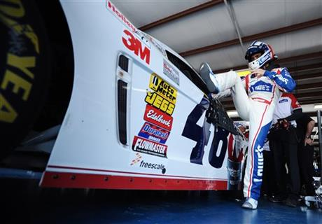 Driver Jimmie Johnson climbs into his car before practice for Sunday's Aaron's 499 NASCAR auto race at Talladega Superspeedway on Friday, May 2, 2014, in Talladega, Ala.